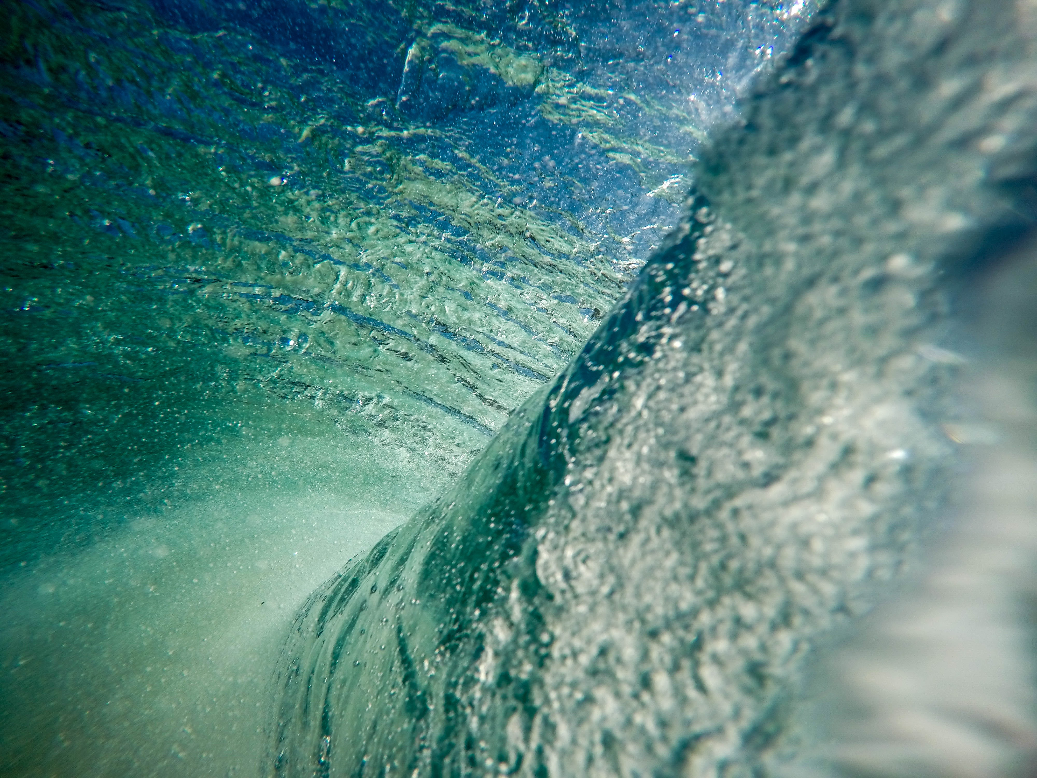 A spectacular view from the inside of a huge swirling sea wave