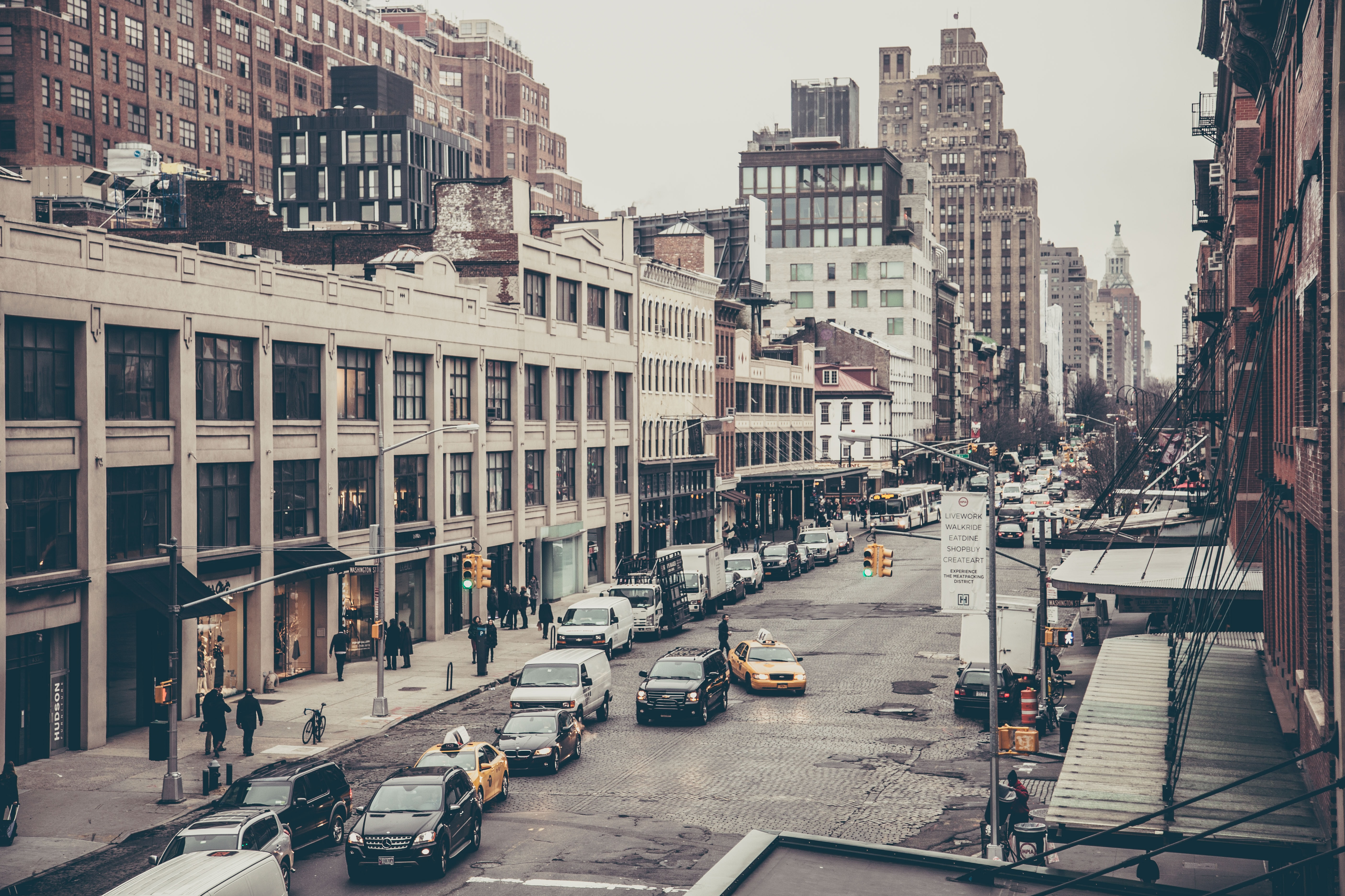 Urban New York City street with brick buildings and traffic