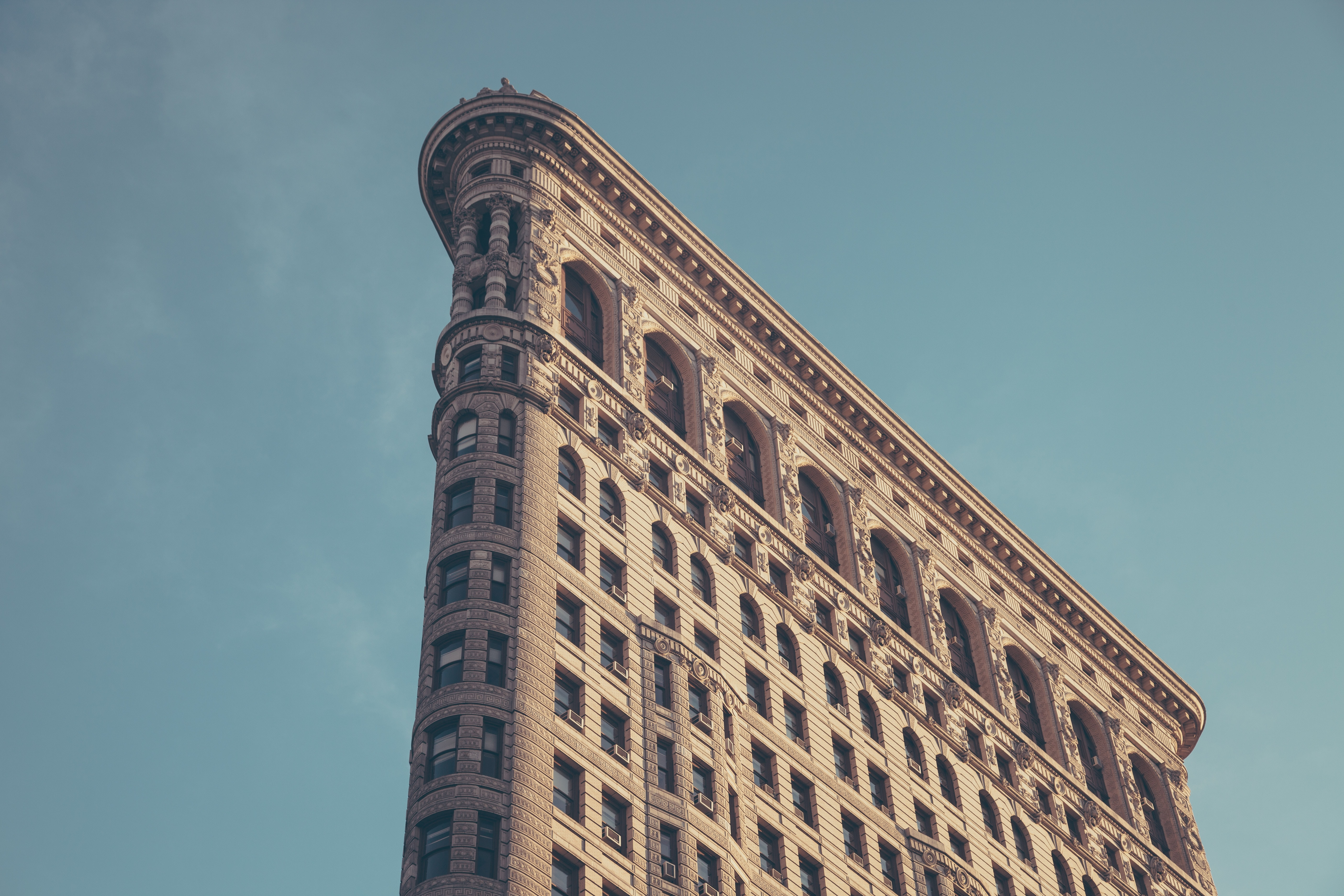 The side of the Flatiron Building in New York against a blue sky