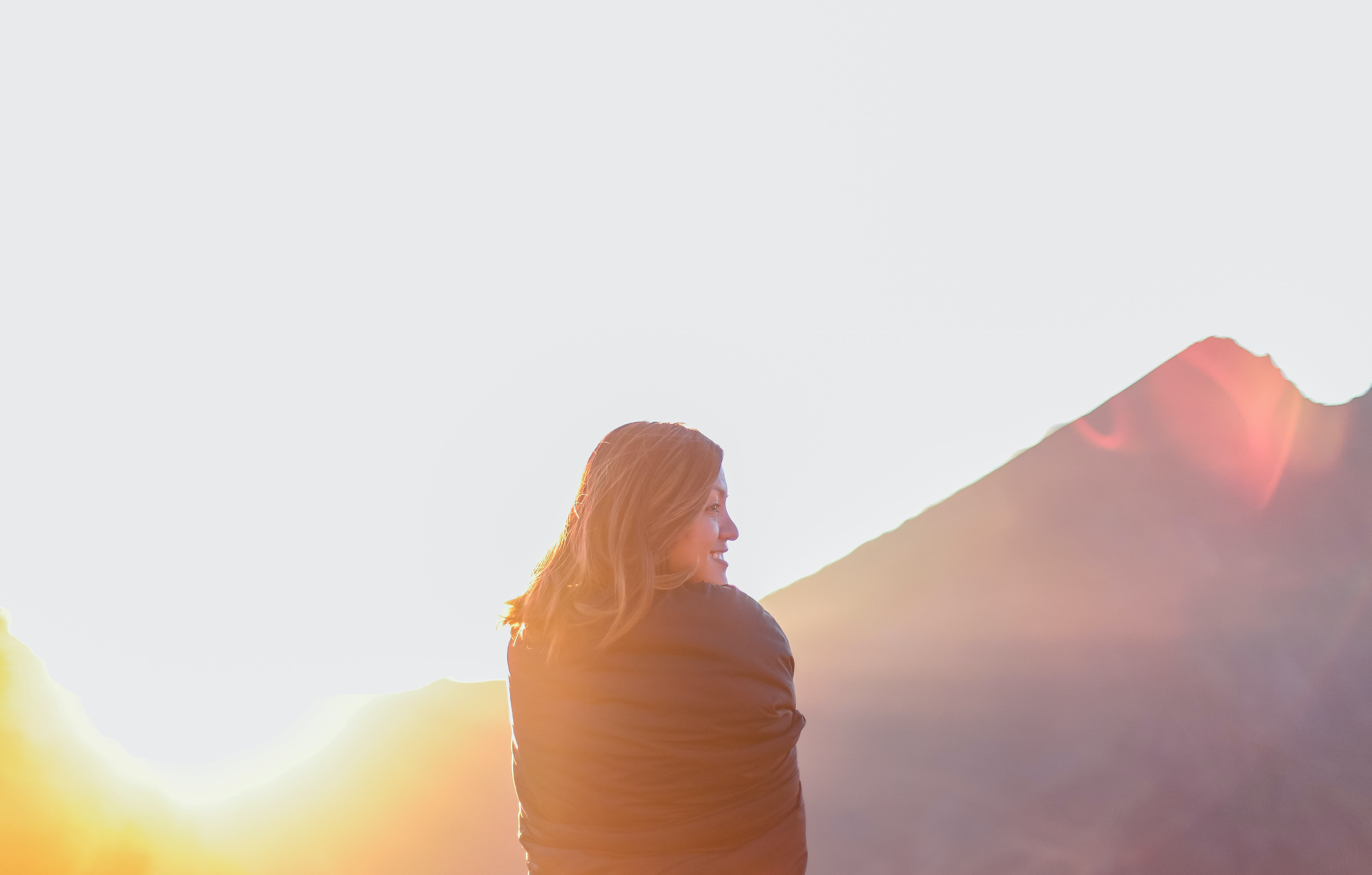 woman standing near mountain during daytime