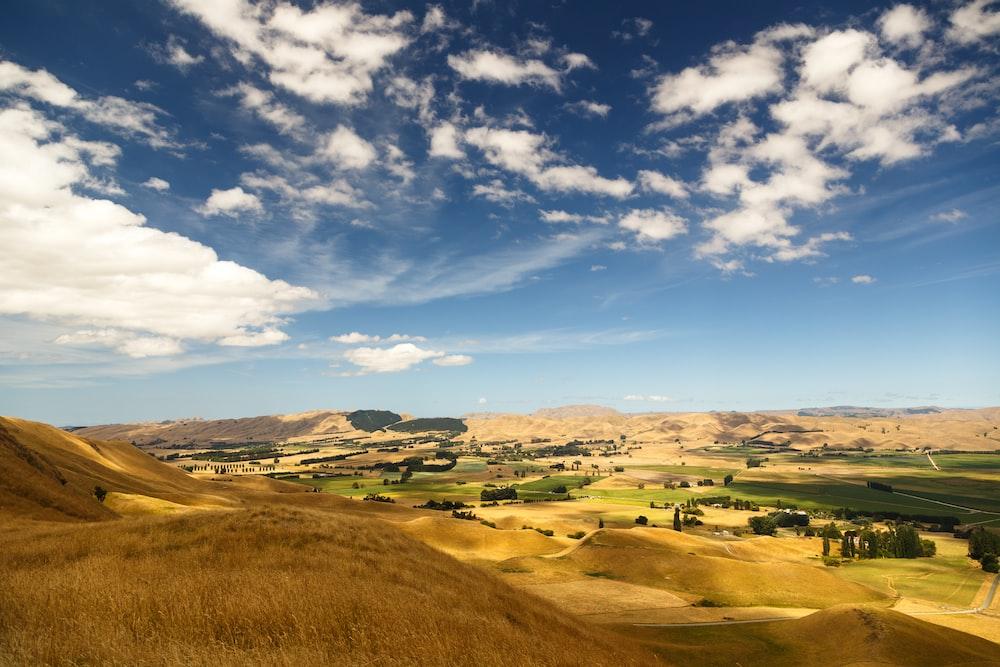 brown hills under cloudy sky