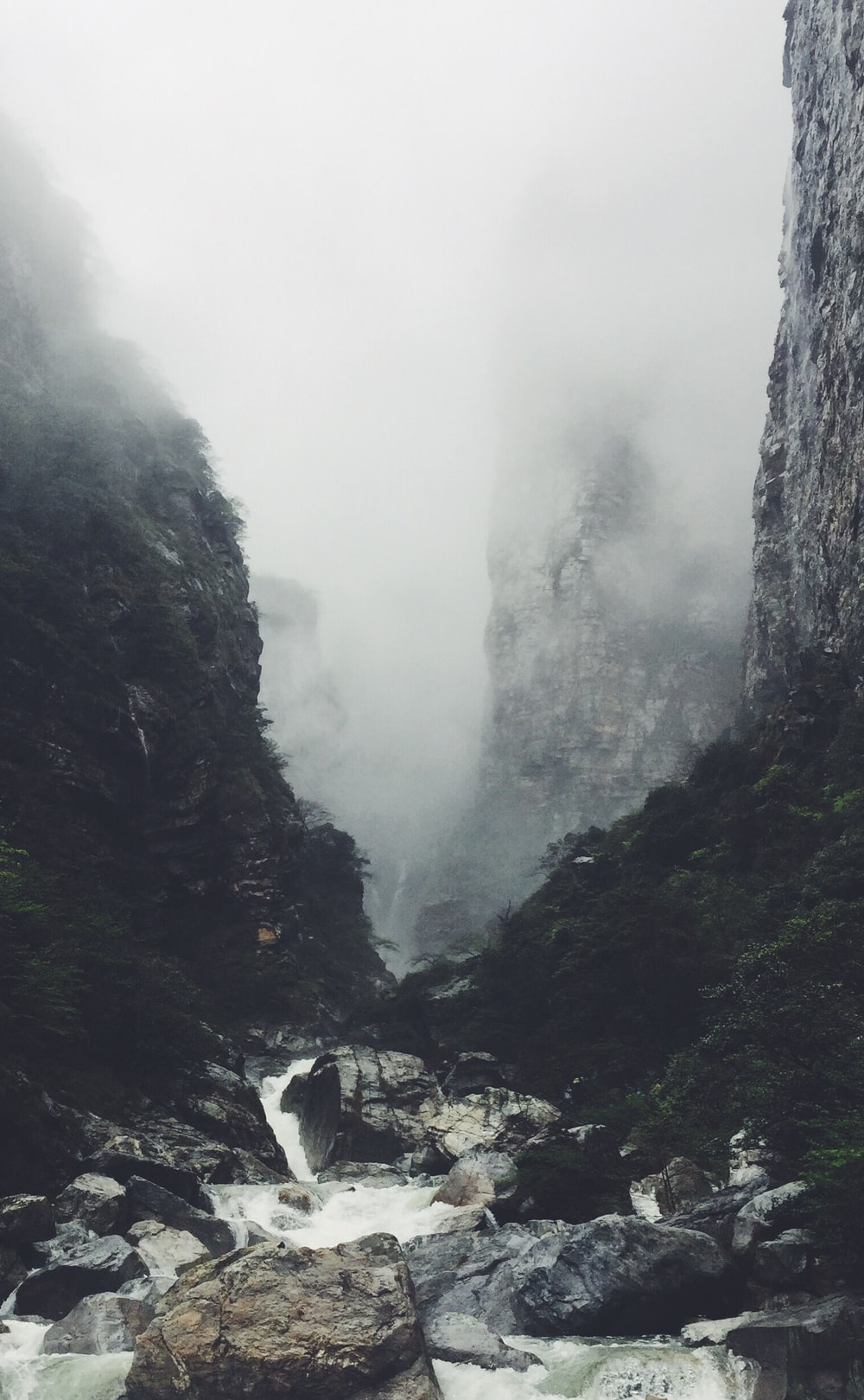 Download iphone wallpapers unsplash fog fills the rocky river valley between mountains voltagebd Images