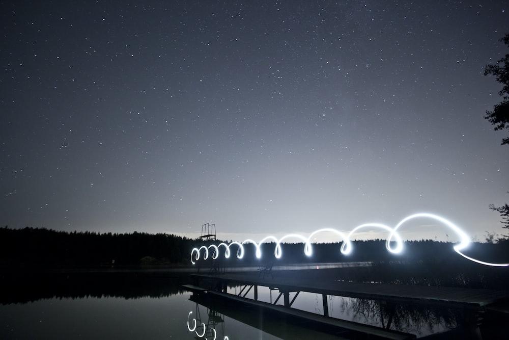 photo of bridge near body of water