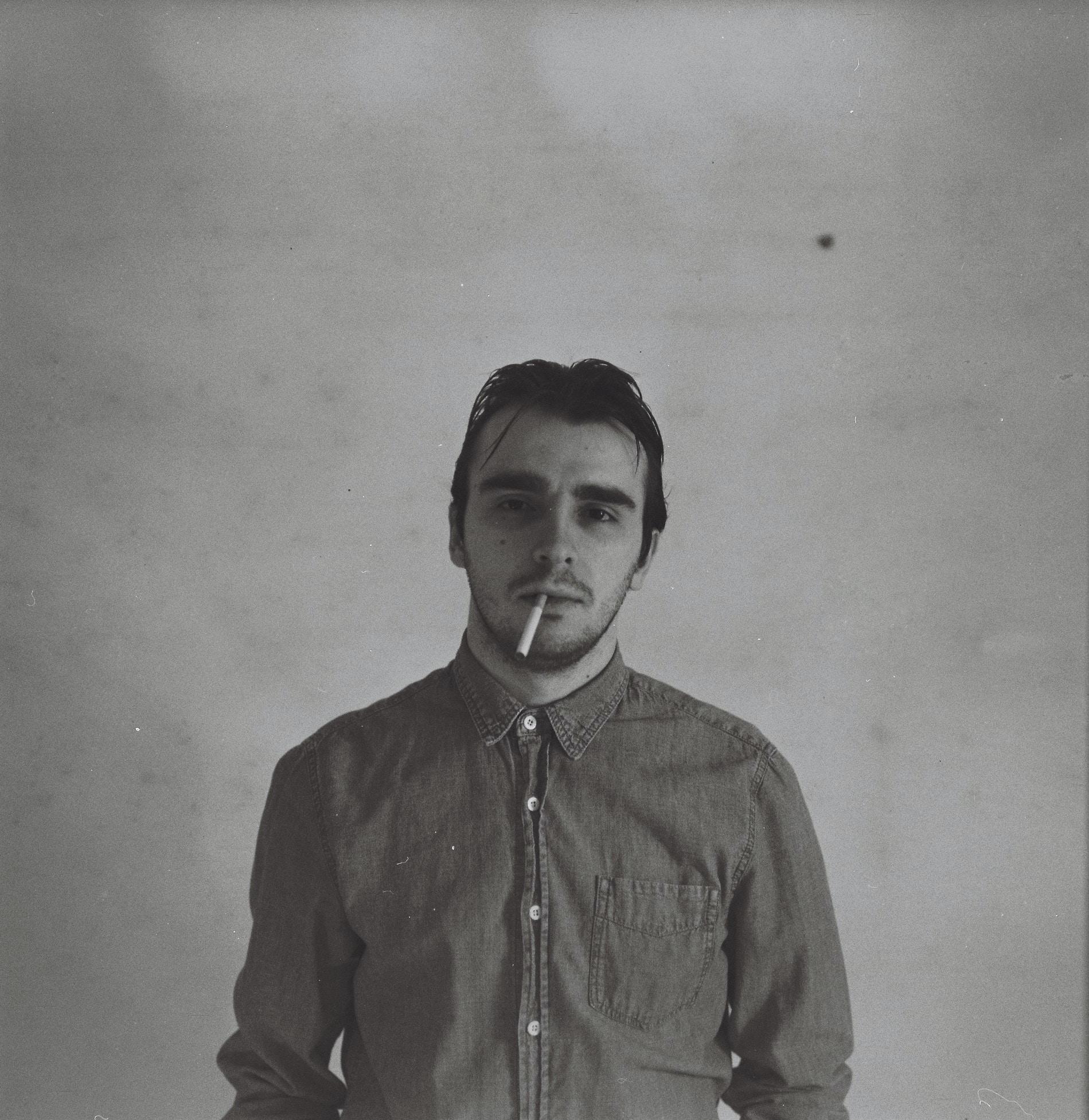 Retro portrait of a man smoking an unlit cigarette