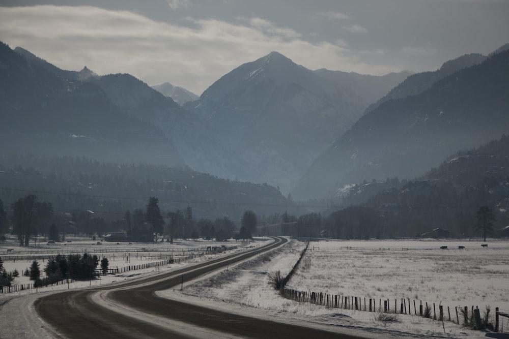 photo of road towards mountains