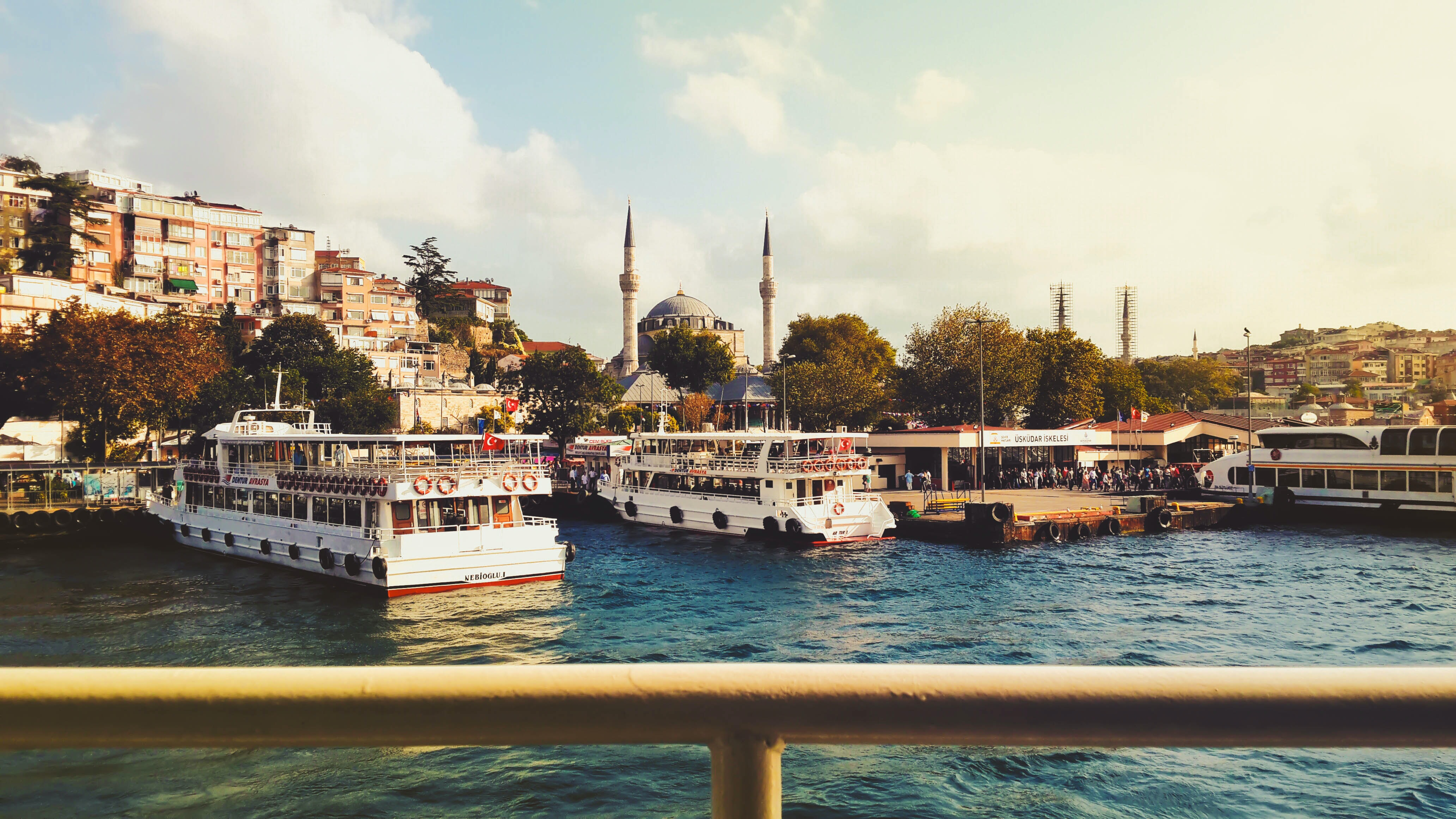 Three boats lined up by a pier in Istanbul, Turkey