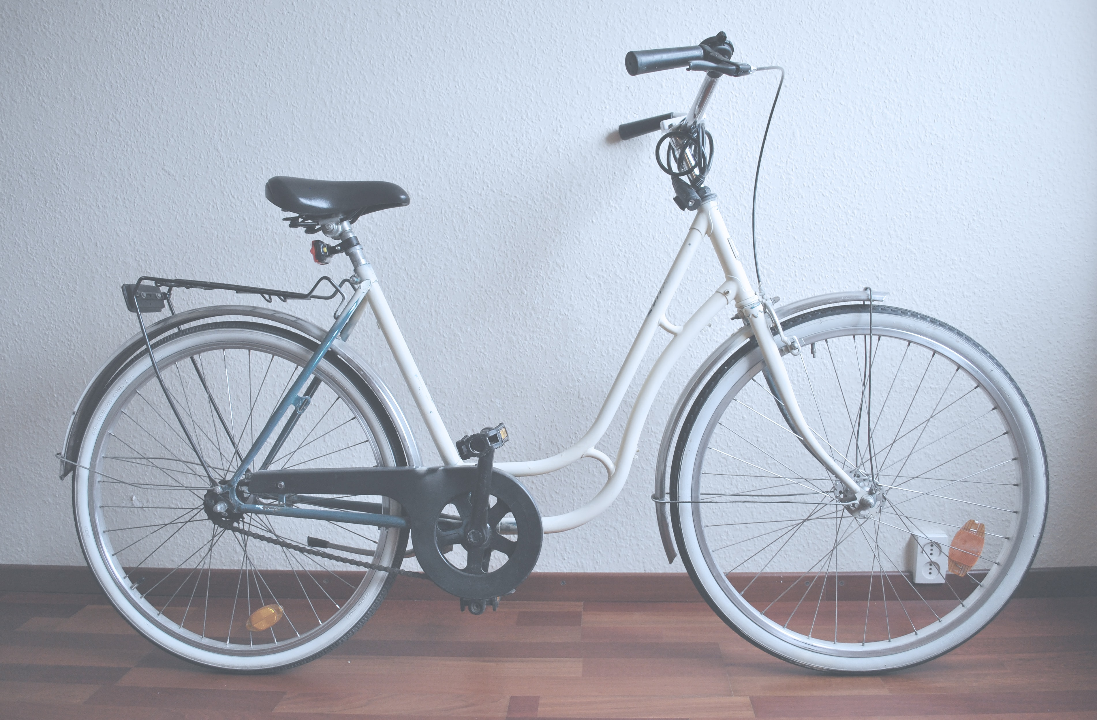 A white bicycle with a lock