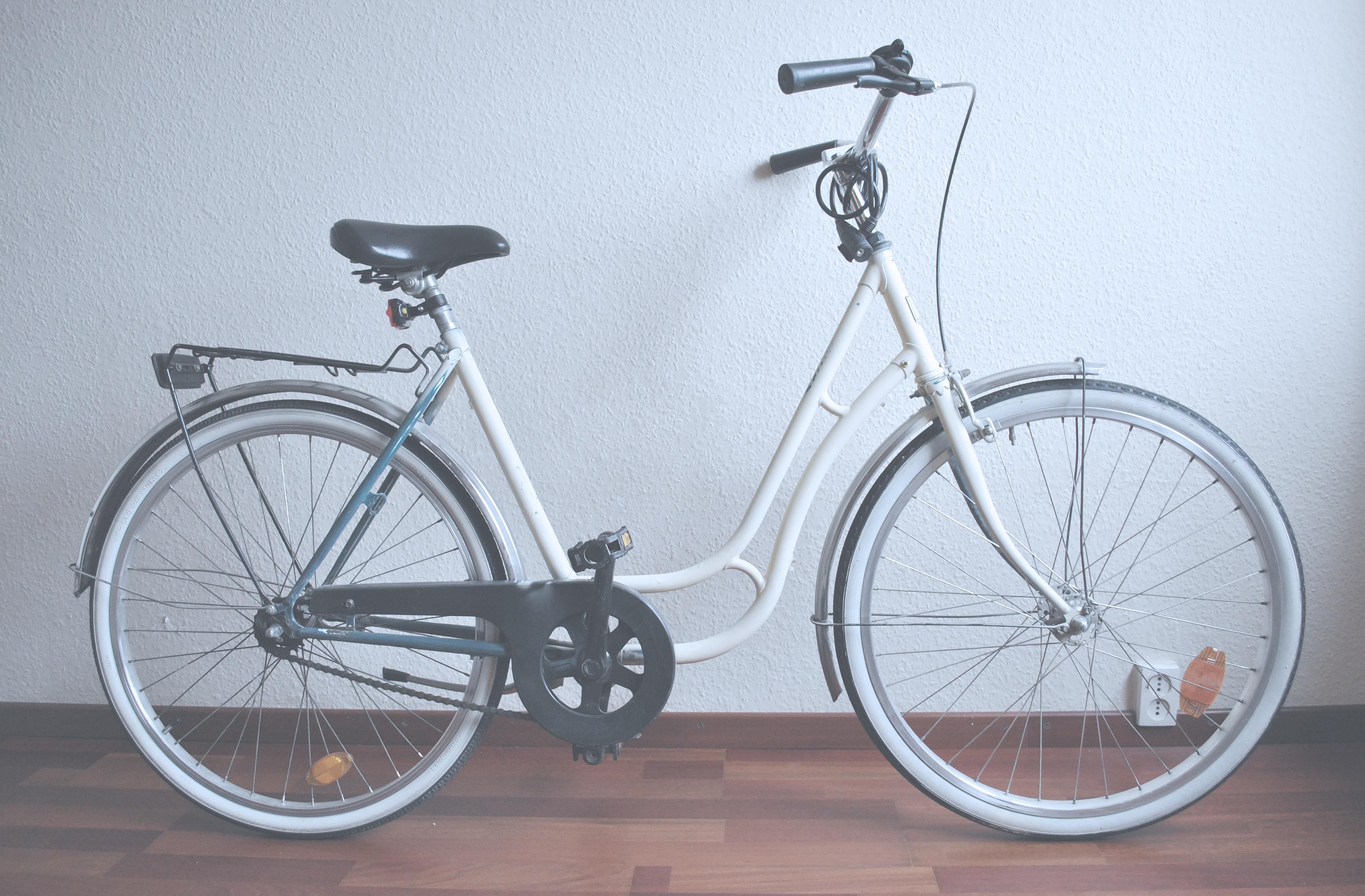white cruiser bike on brown parquet floor