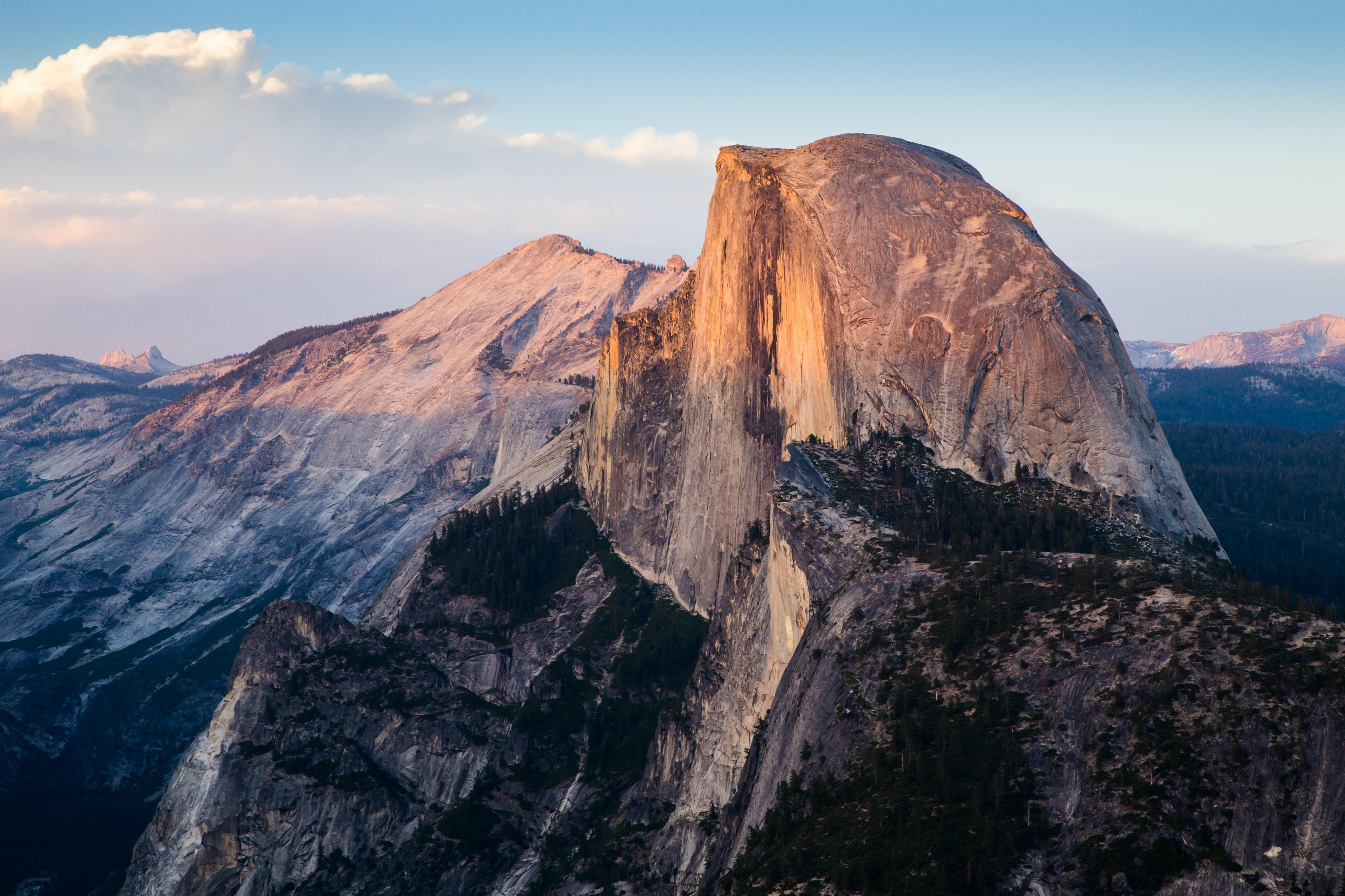 A steep mountain peek at the edge of a sharp mountain ridge