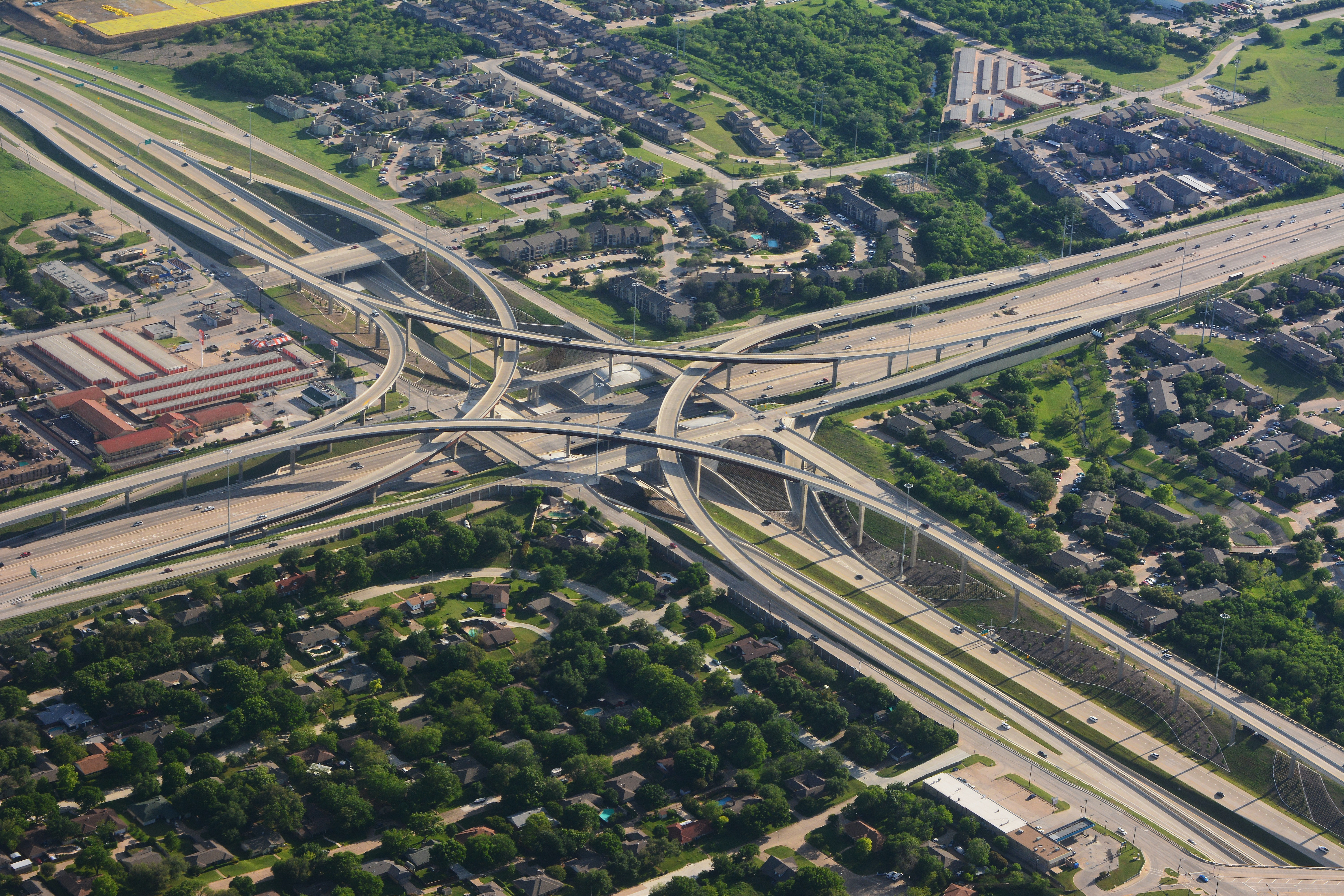 Drone view of a busy highway and buildings