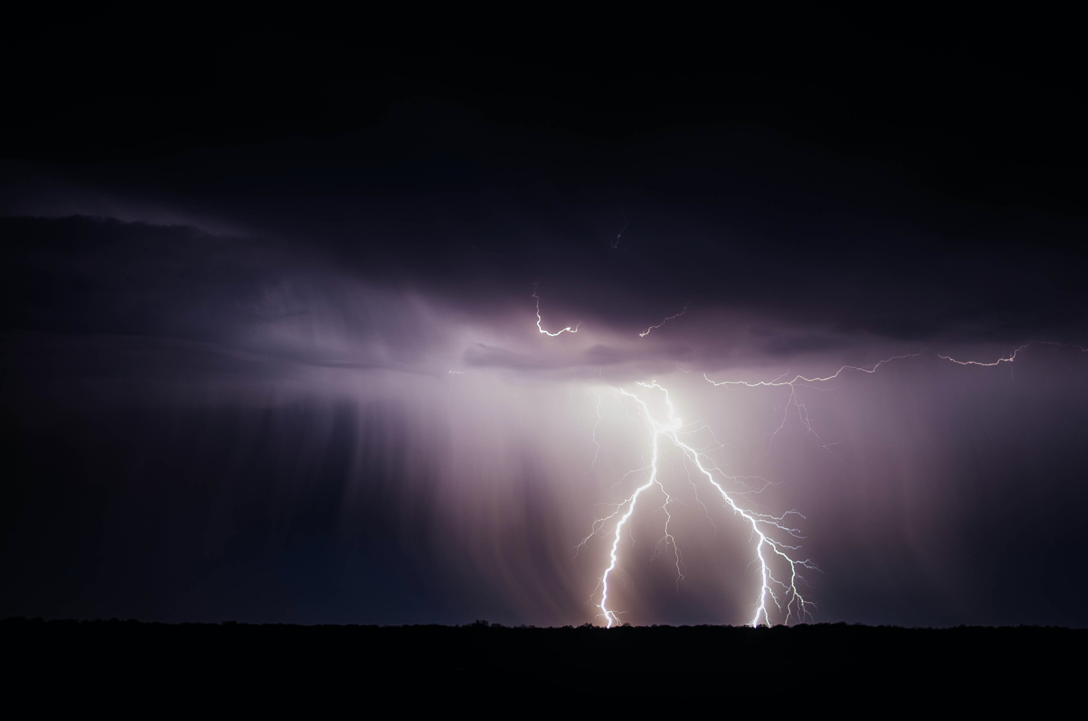 selective focus photography of thunder