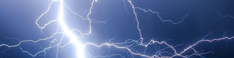 lightning strike during blue sky