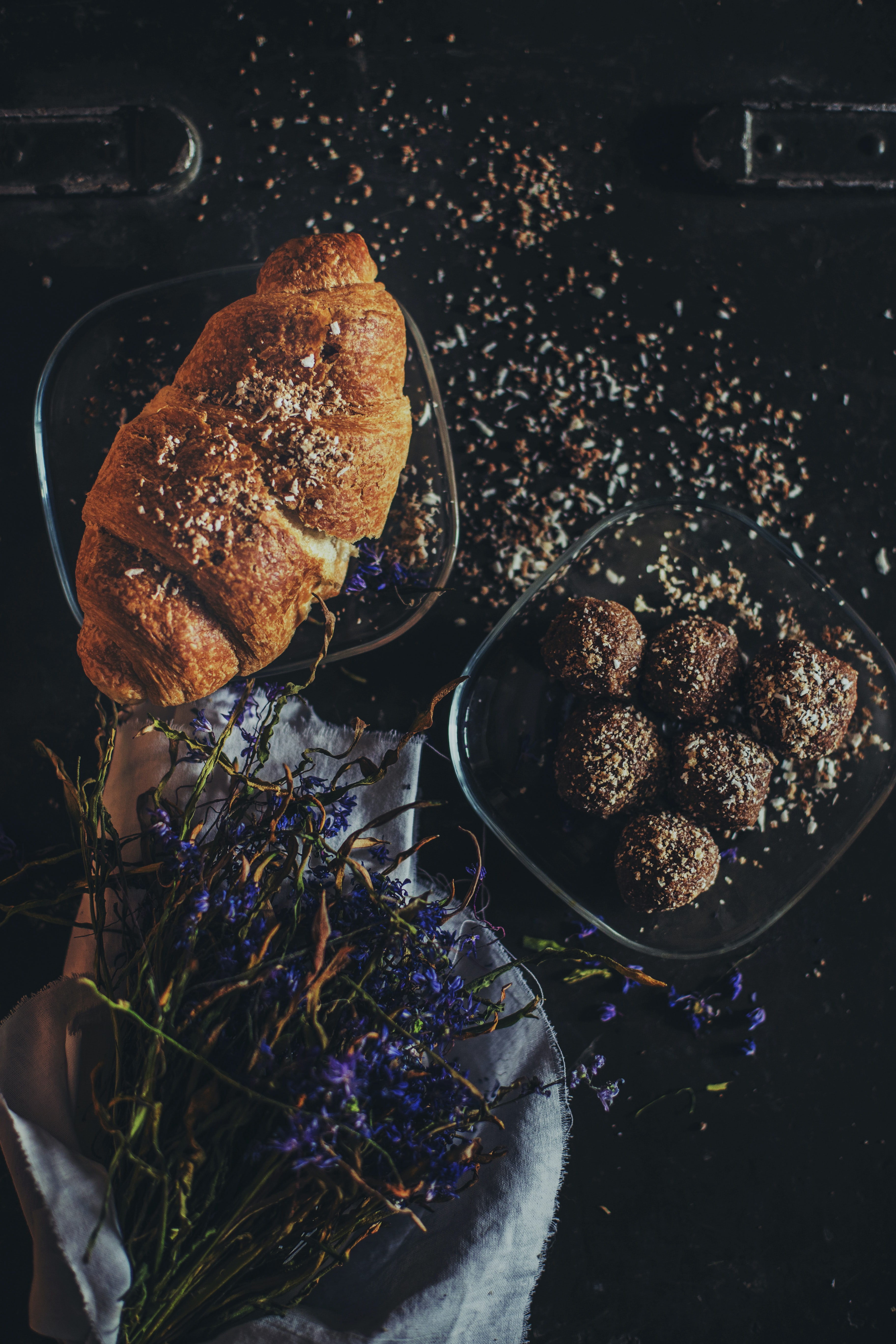 Rustic bakery tablescape with french croissant, chocolate truffles, and dried flowers