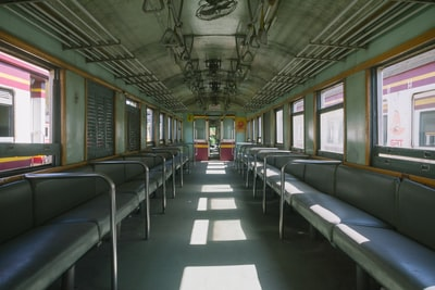 structural photography of green train coach