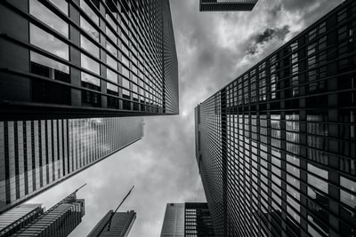 worm's-eye view of buildings building teams background