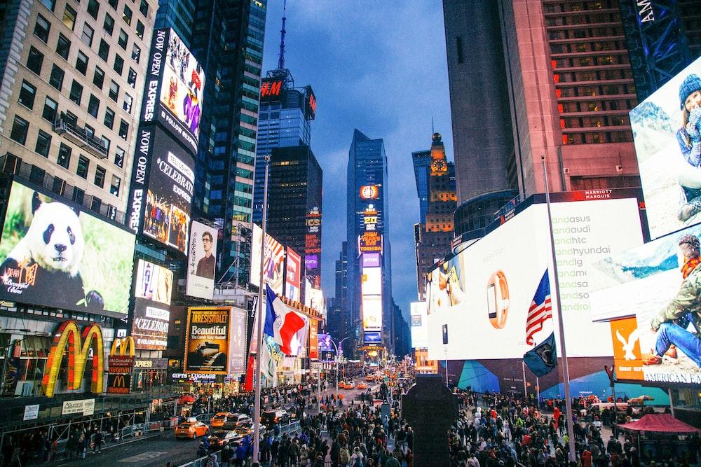 people standing near billboards