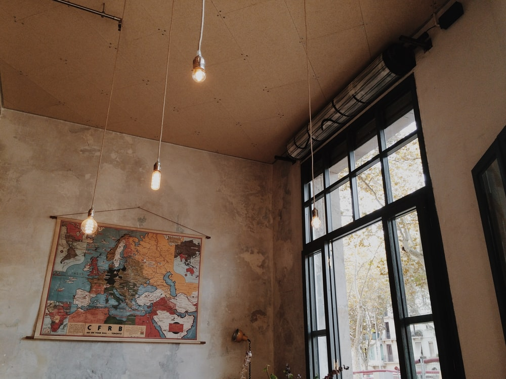 gray pendant lamps inside concrete building at daytime