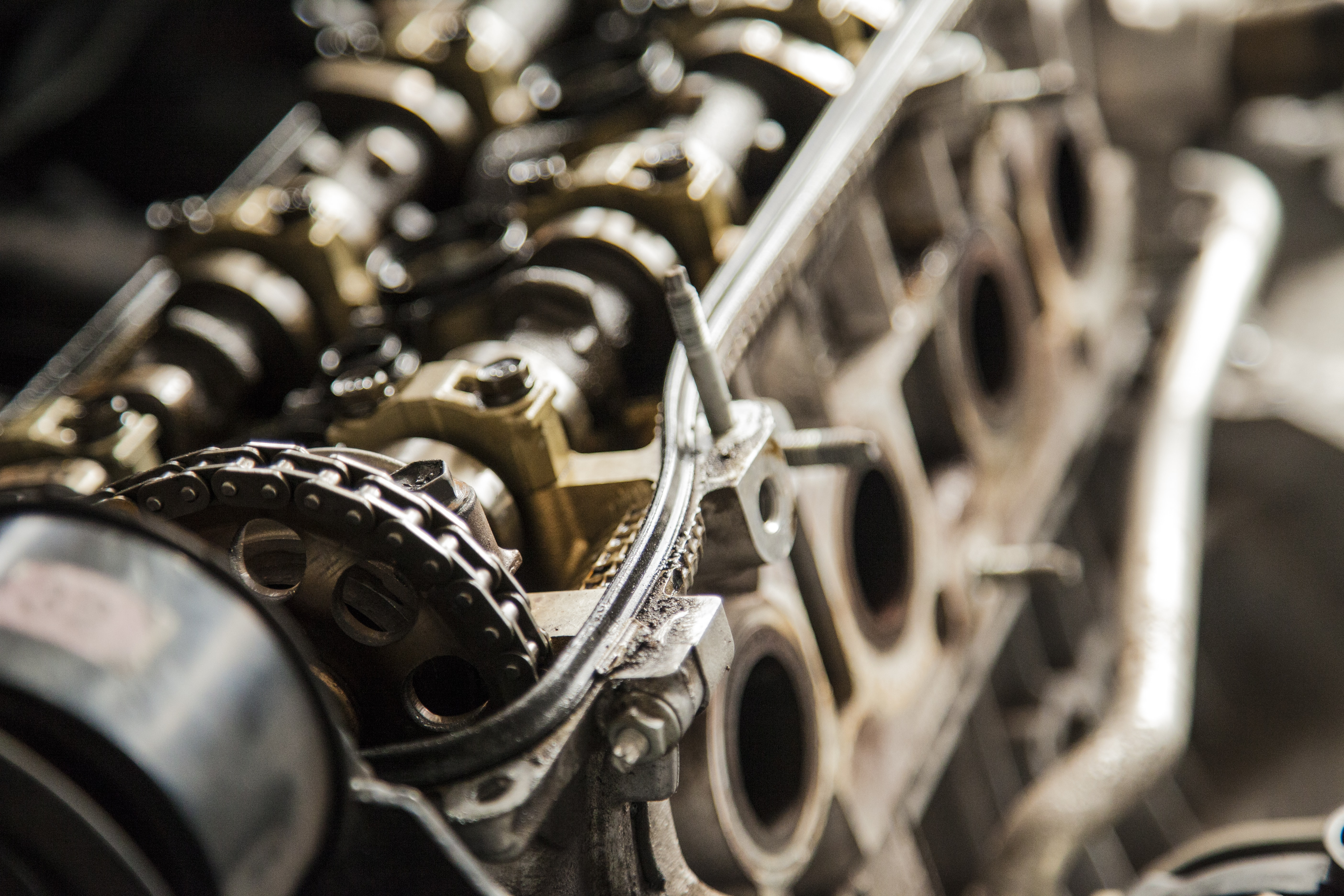 A vintage looking metal machine engine block with gears and cogs