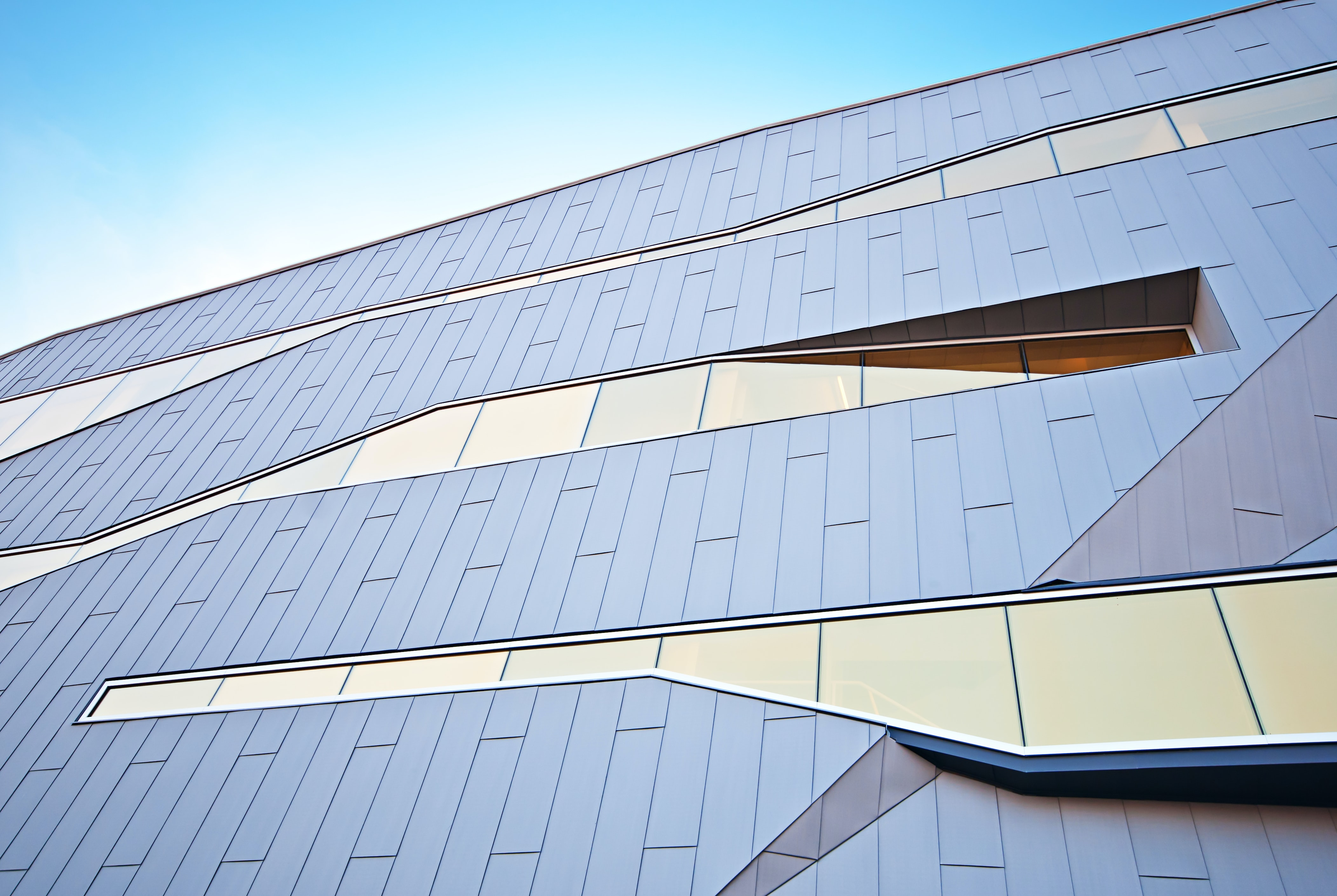 Modern building design with distinctive unique shaped glass windows
