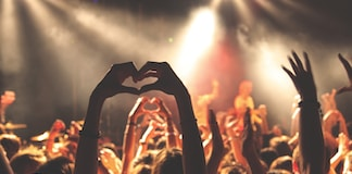 person performing heart hand gesture