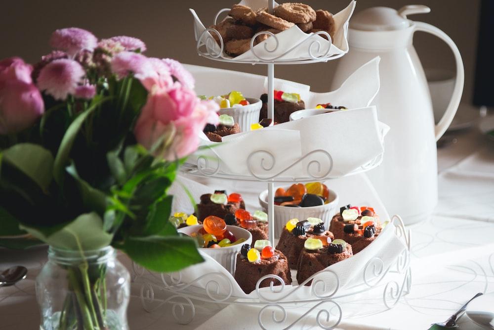 cupcakes on white metal cupcake stand