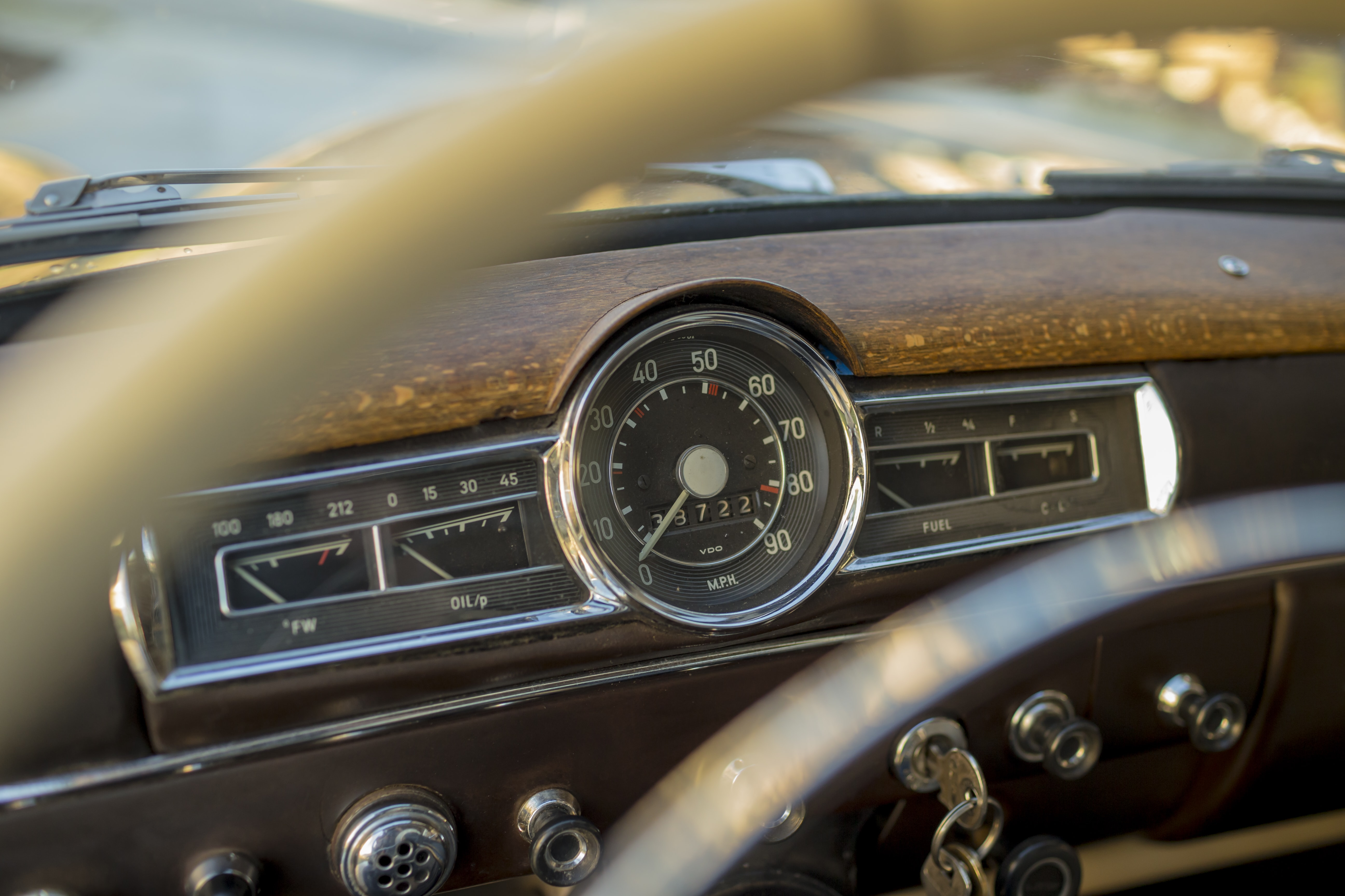 Close up of the dashboard of a vintage car.