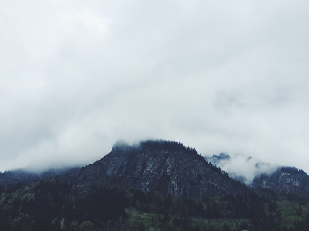 photo of clouds covering mountain