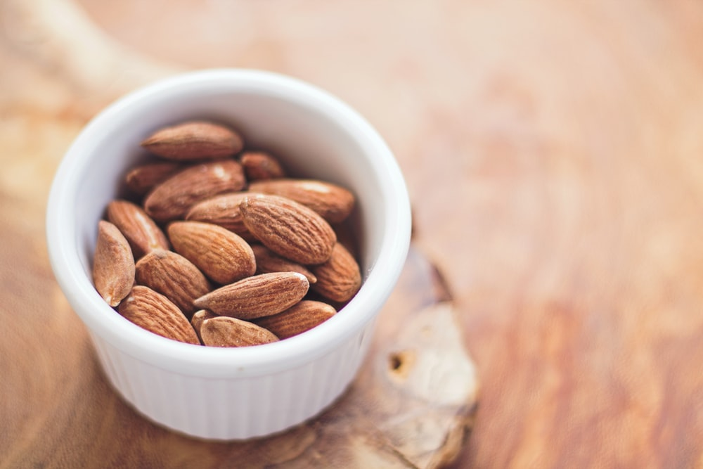 Ramekin of raw almonds for a healthy snack