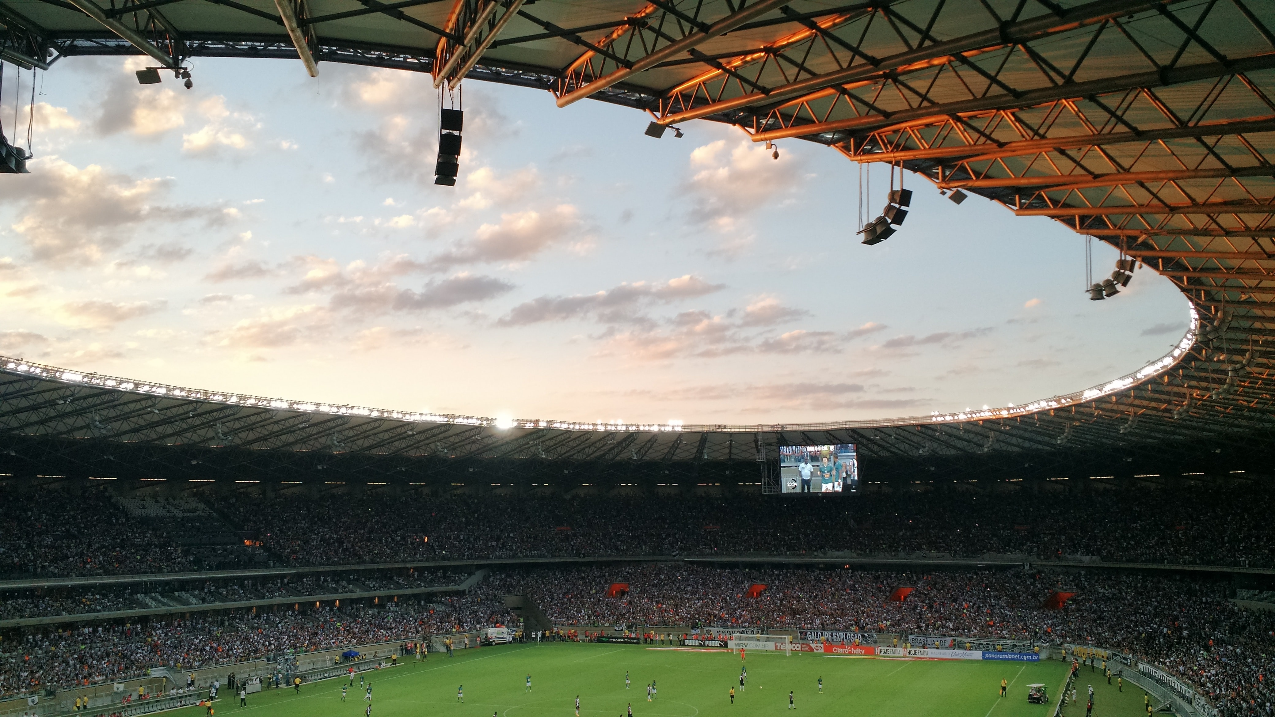 Late afternoon view of a crowded soccer stadium during the match