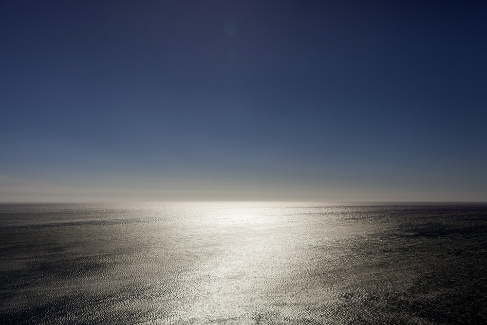 aerial photography of calm sea under blue skies