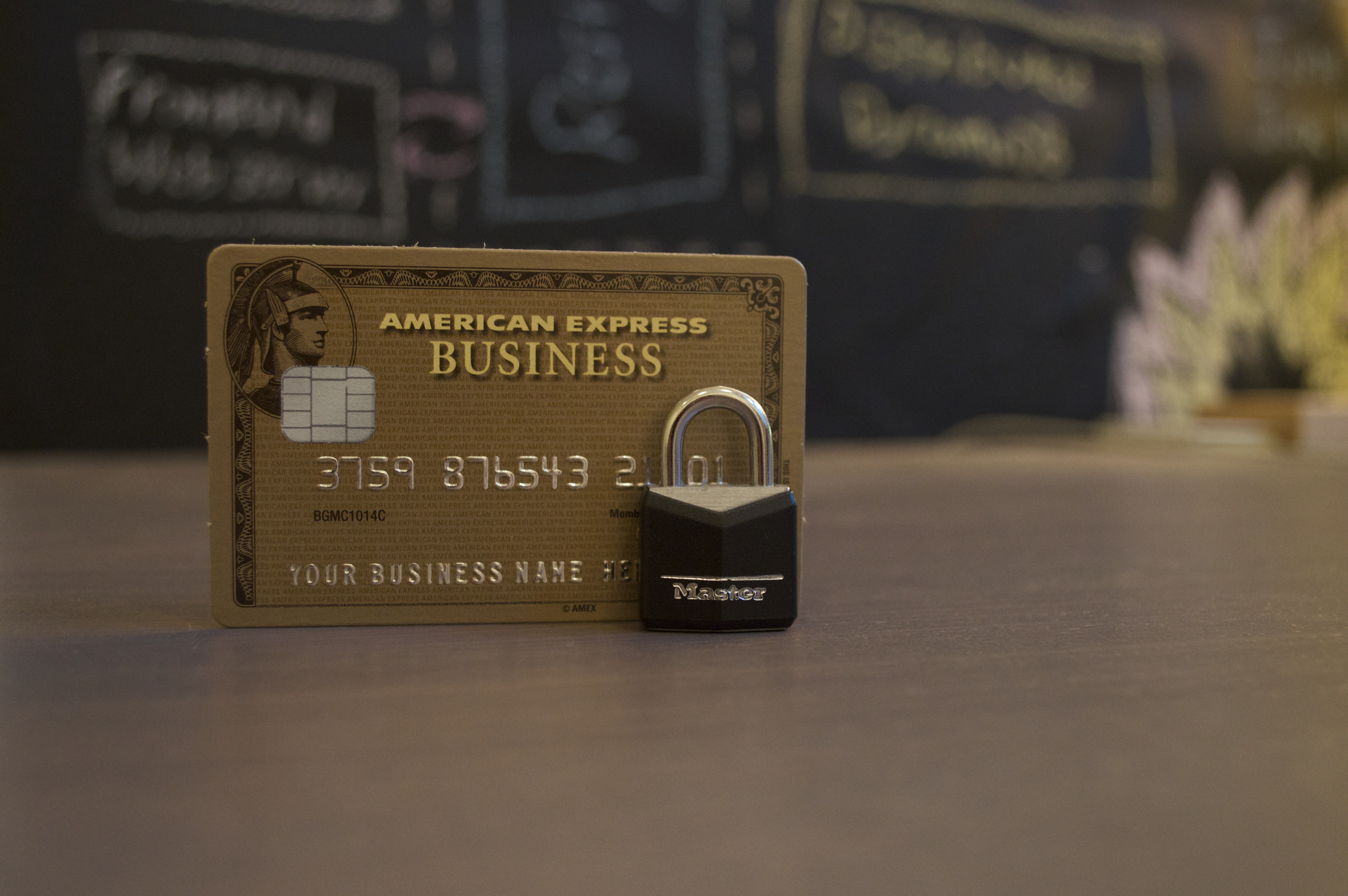 A lock in front of an American Express Business credit card.