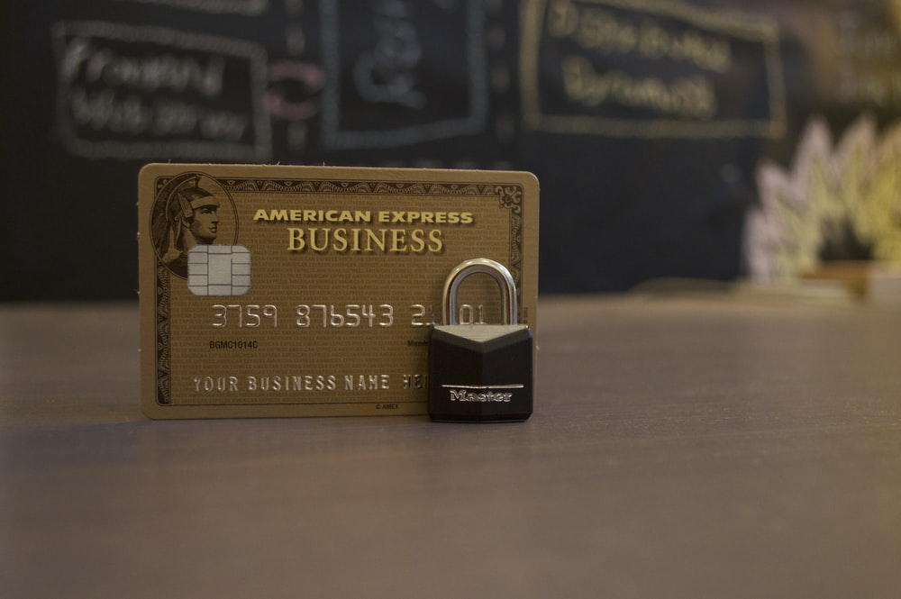 closeup photo of American Express Business card on brown surface