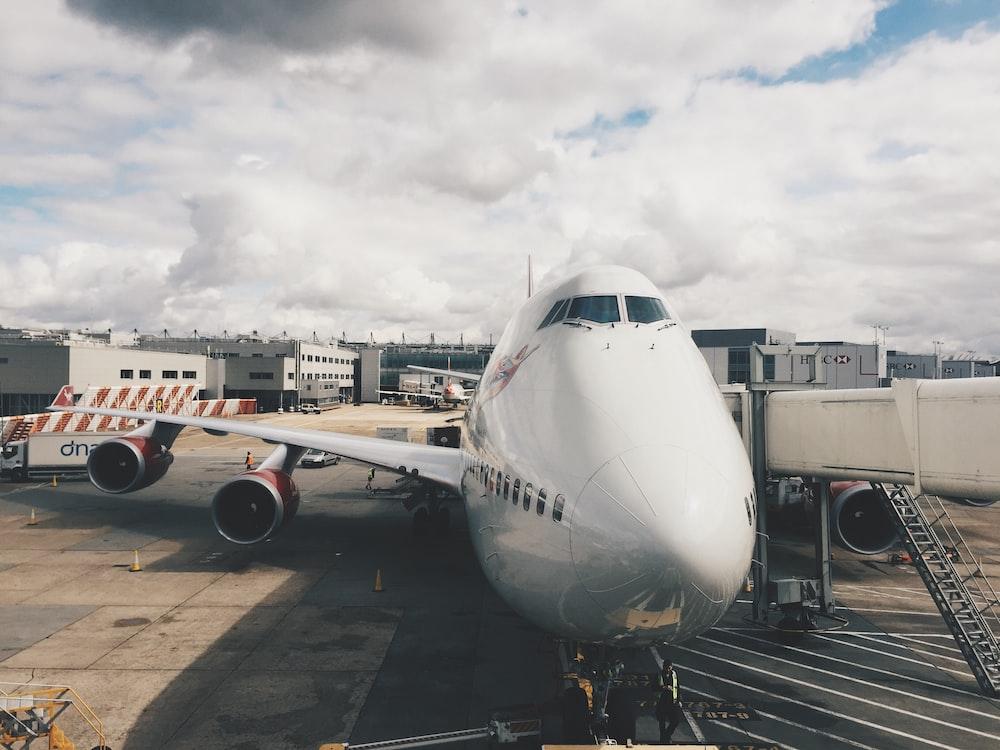 white airplane on gray concrete floor