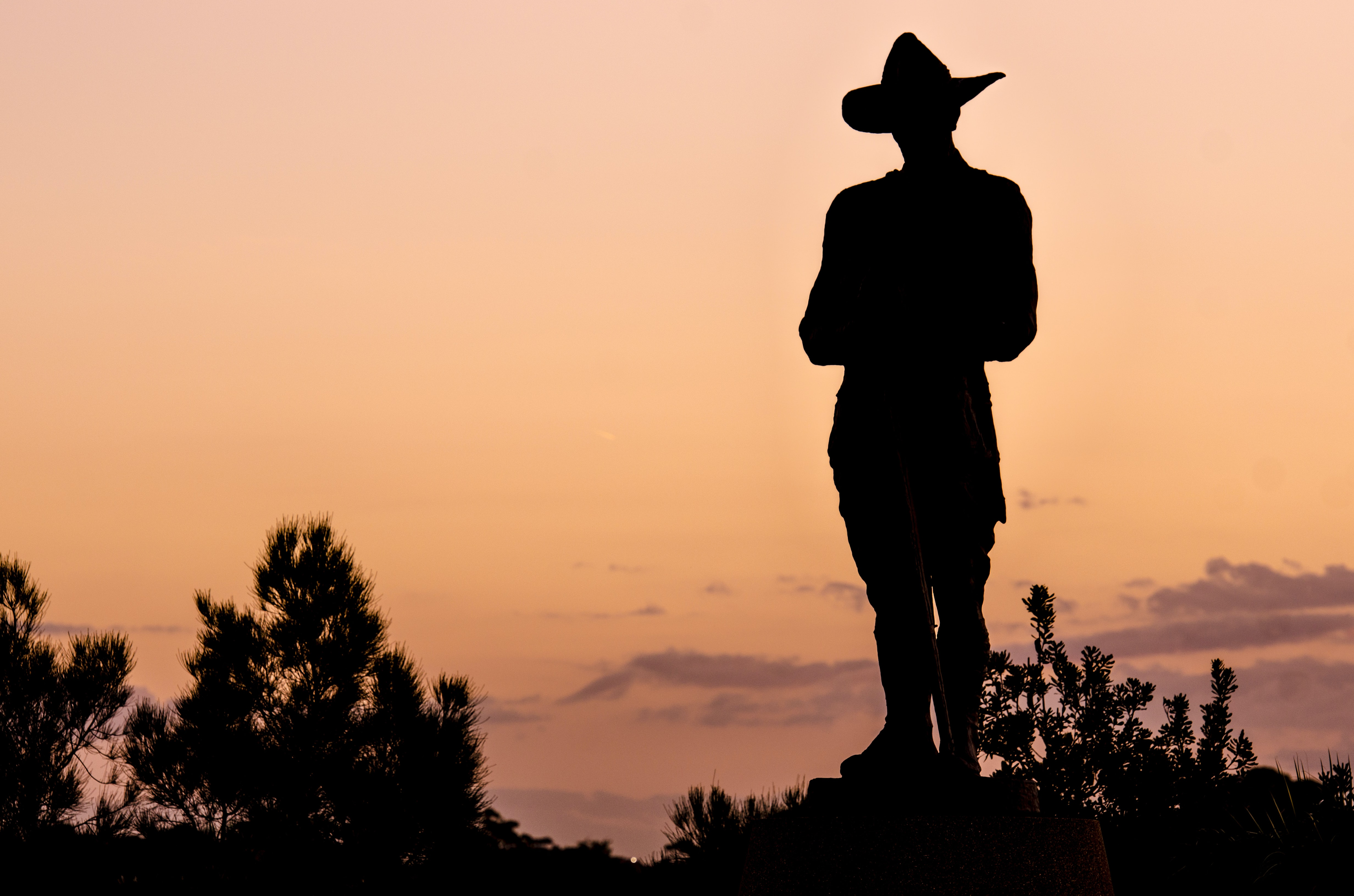 silhouette of person wearing hat