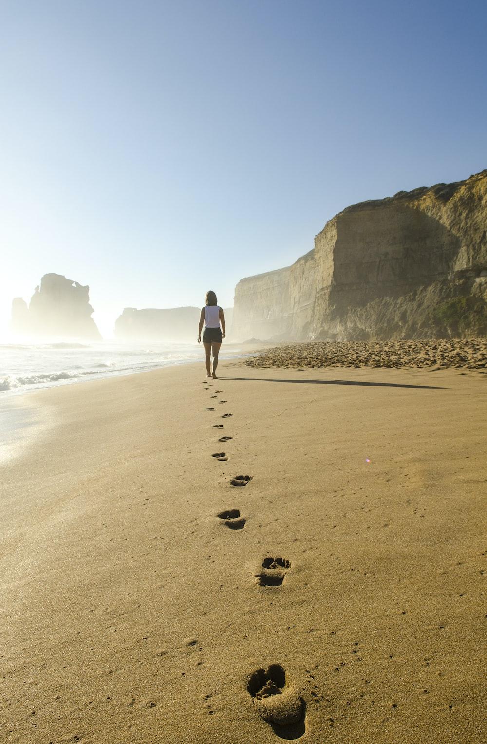 woman walking on shore