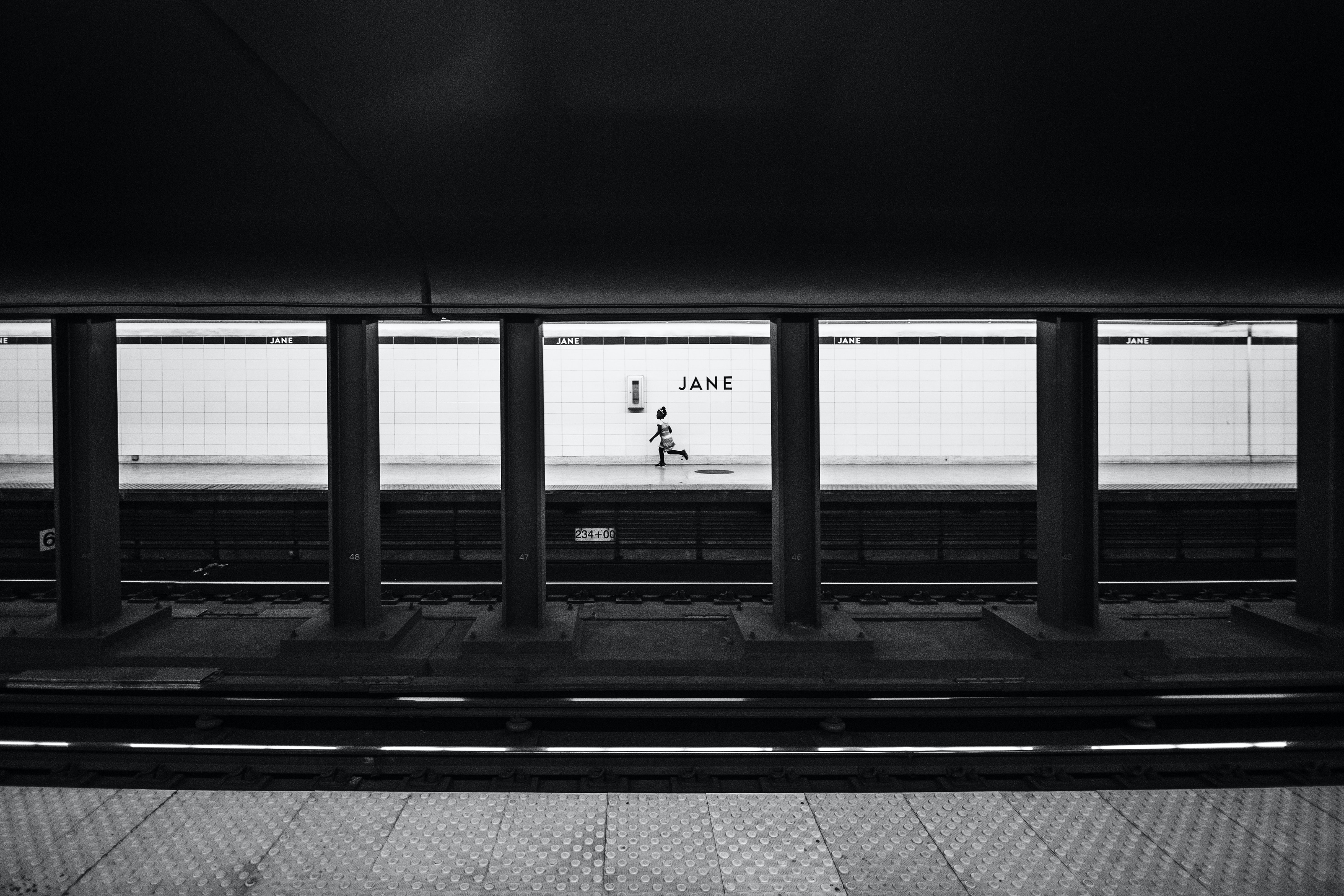 A person running on a subway platform after missing the train
