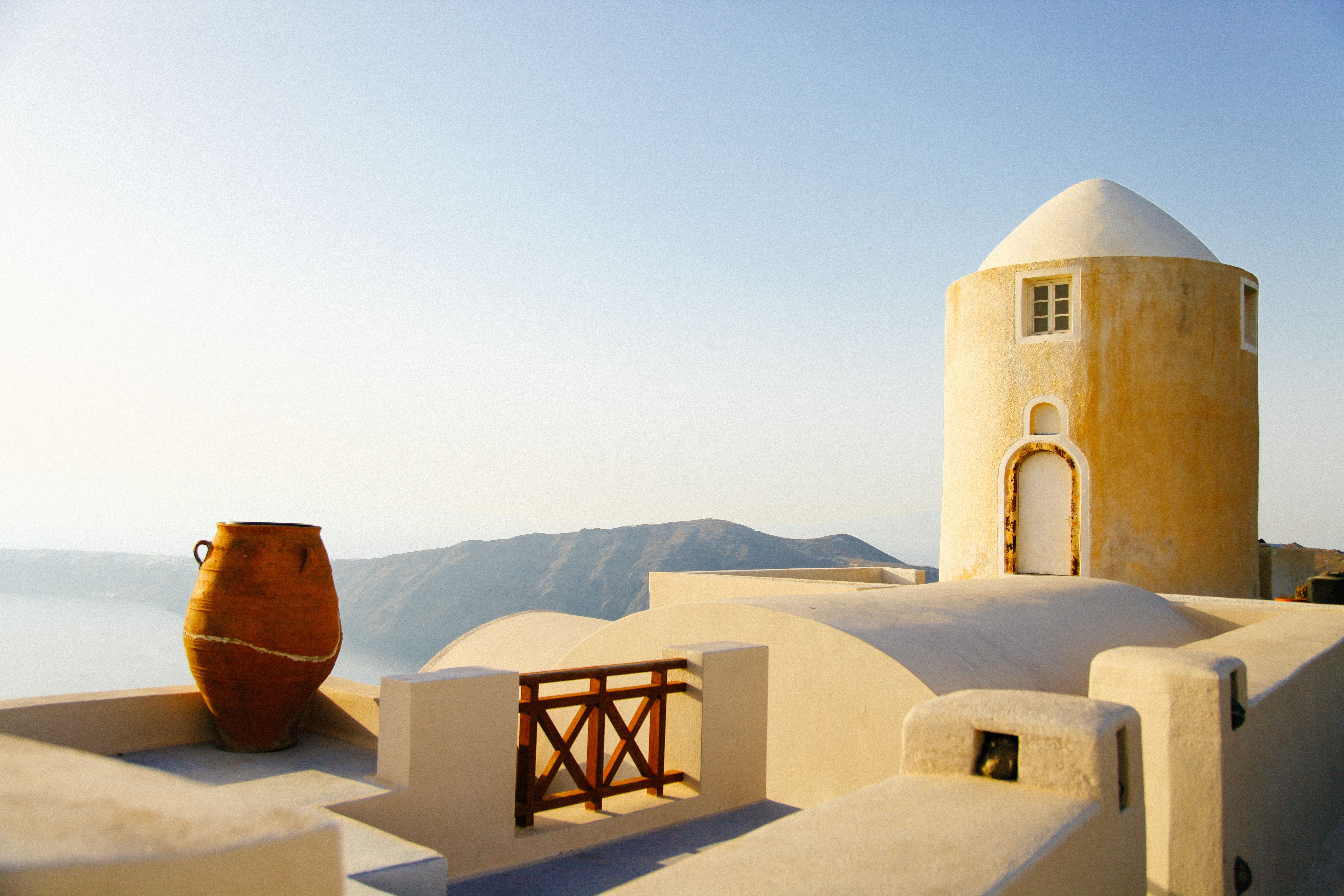 A stone building with a dome in Santorini