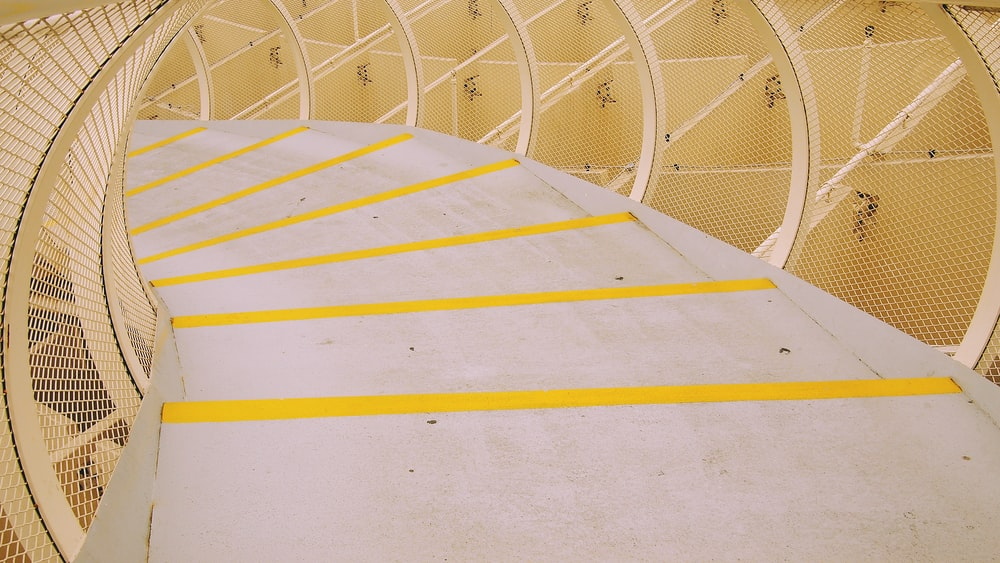 photo of white and yellow concrete stairs