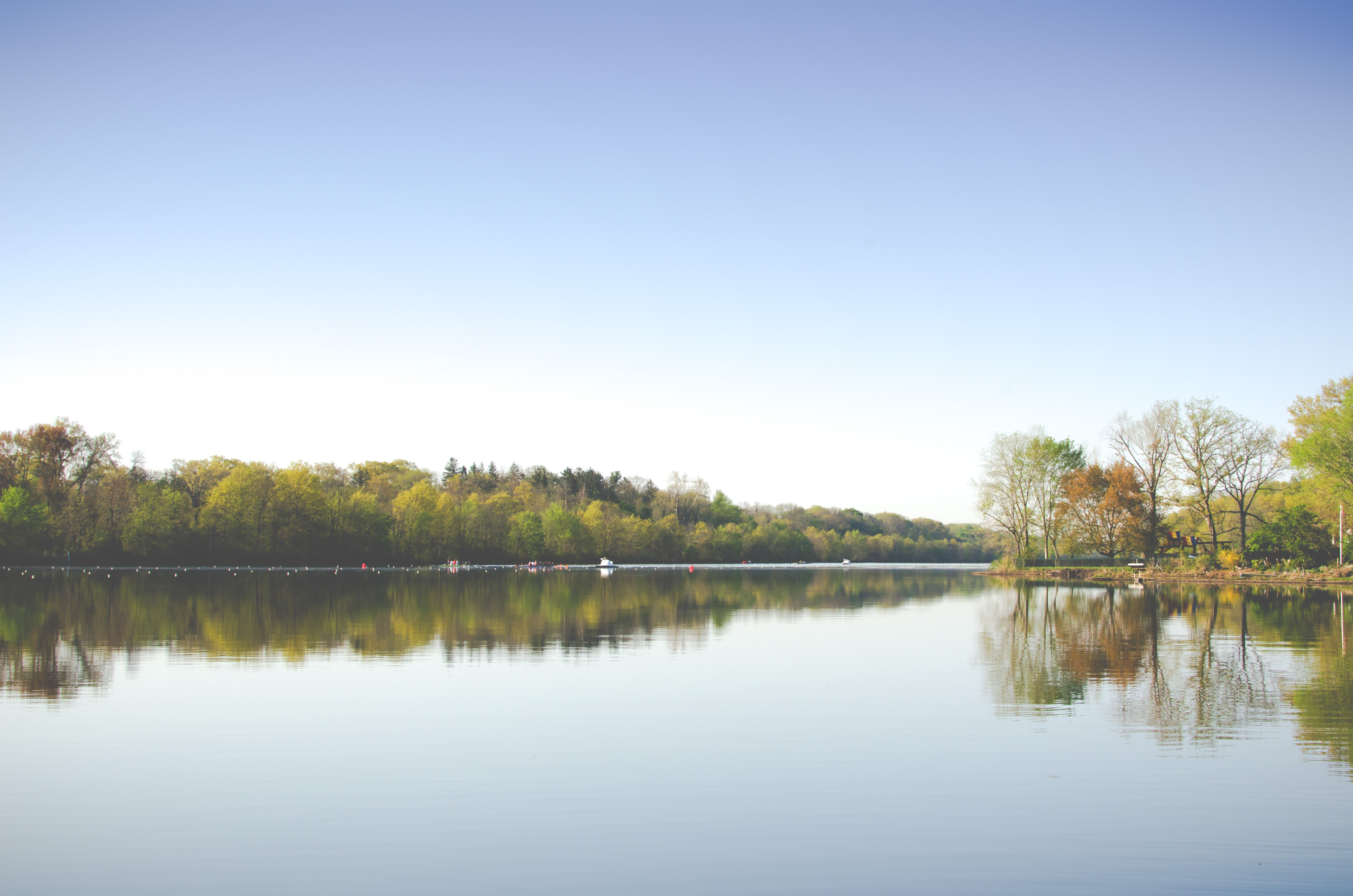 The calm surface of a lake on a sunny autumn day