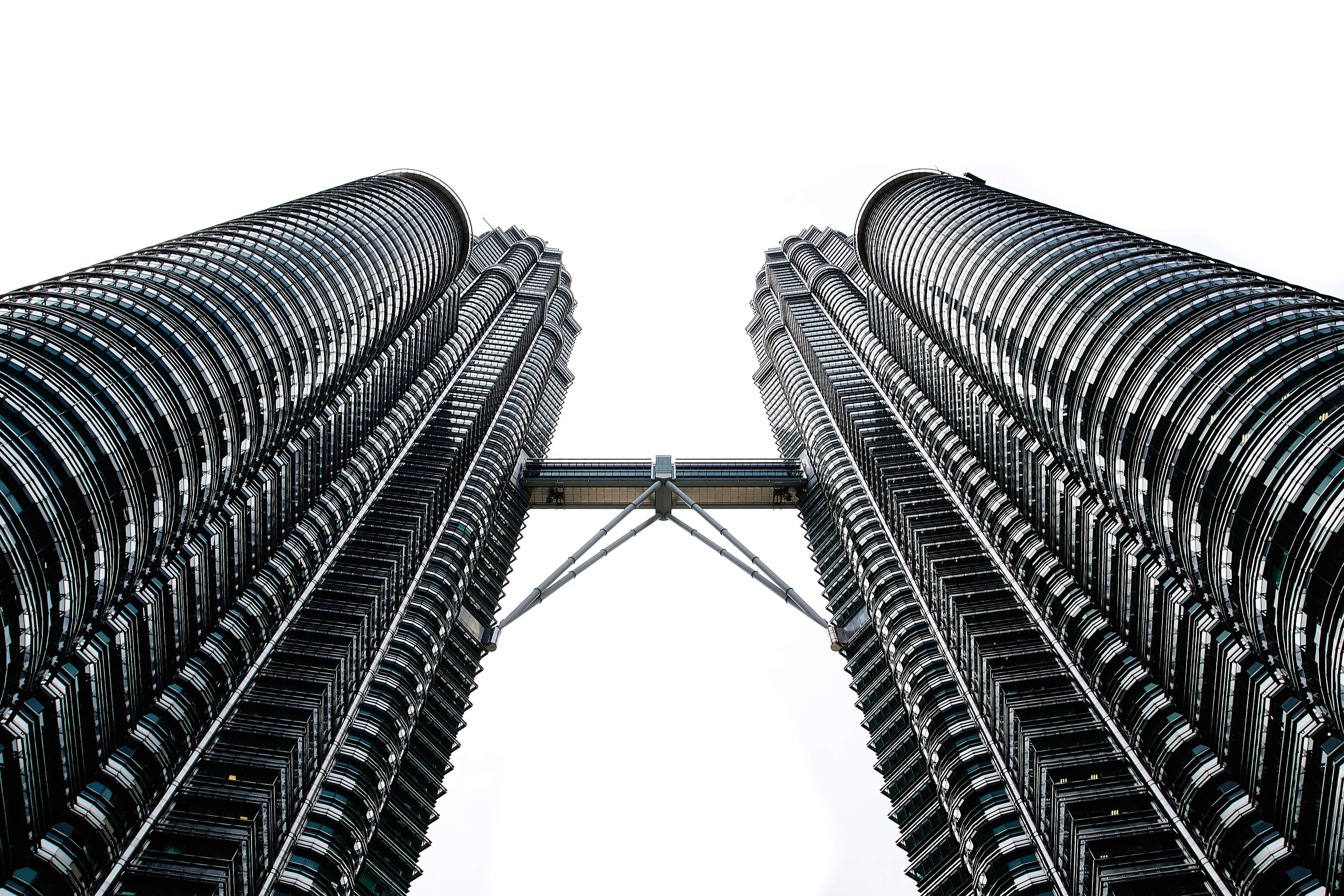 The twin towers of the Petronas Towers complex connected with a skybridge