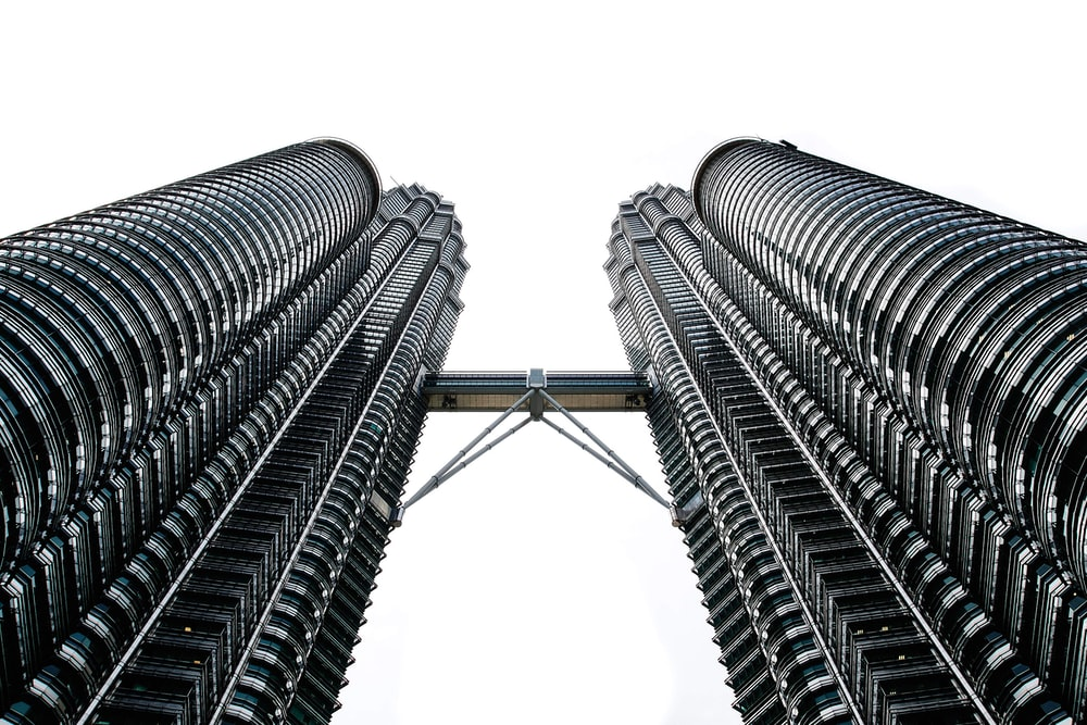 worms eyeview photography of Petronas Tower during daytime