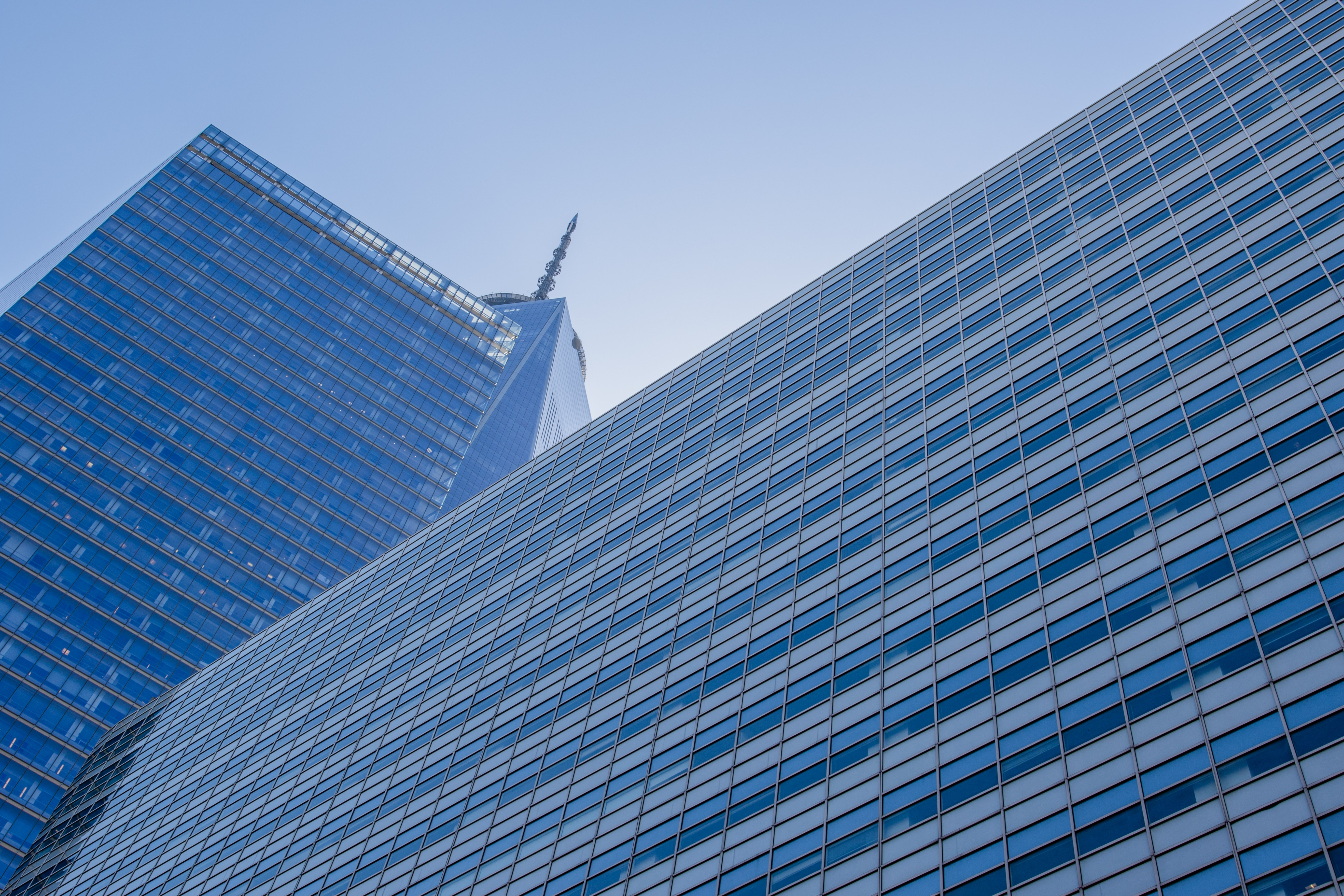 worm's-eye view photography of blue concrete building under clear blue sky