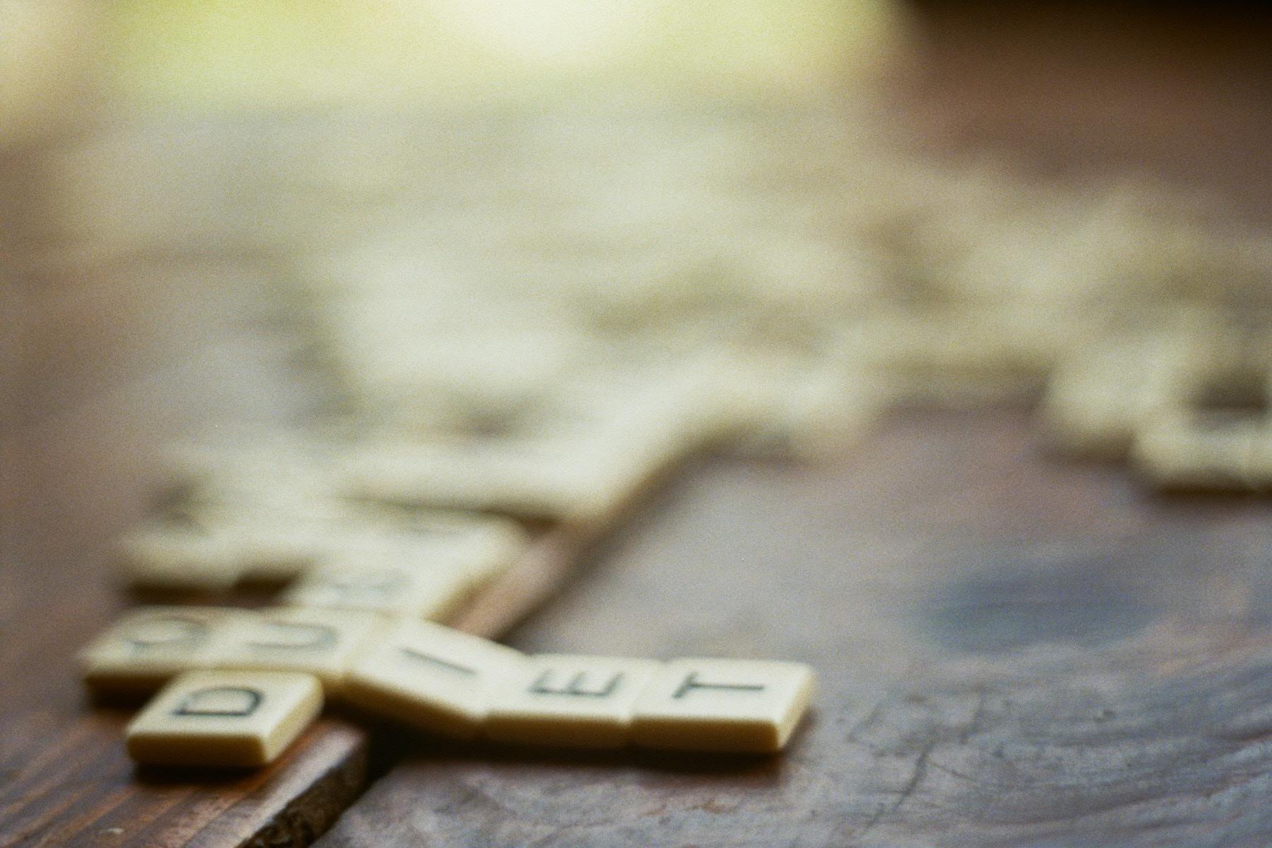 Scrabble tiles out of focus