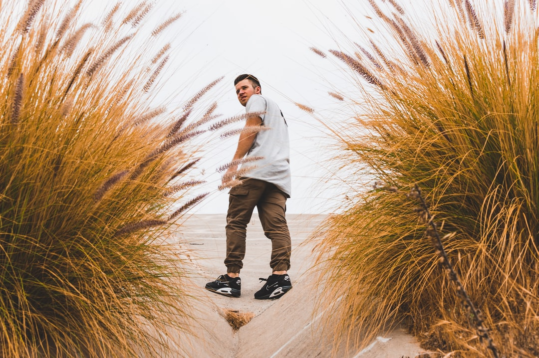 Man in sneakers at beach