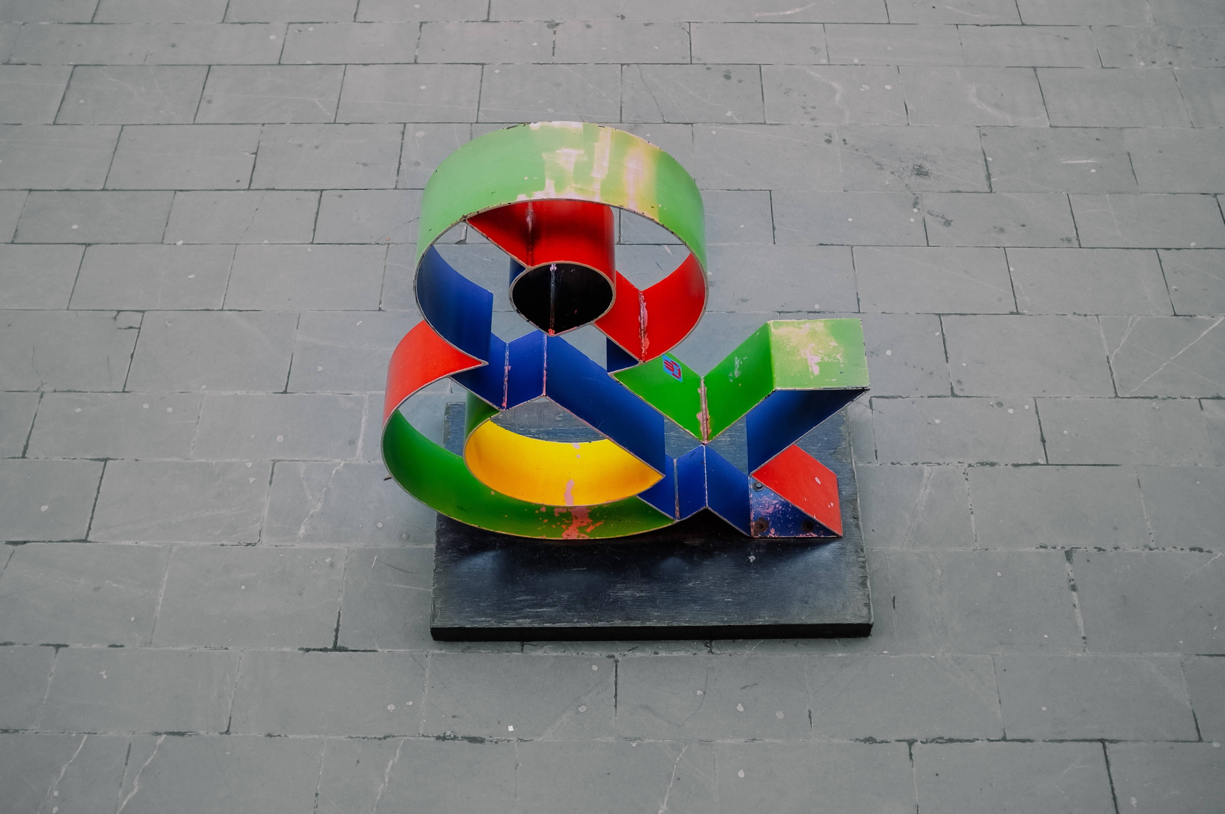 A color and symbol statue outside.