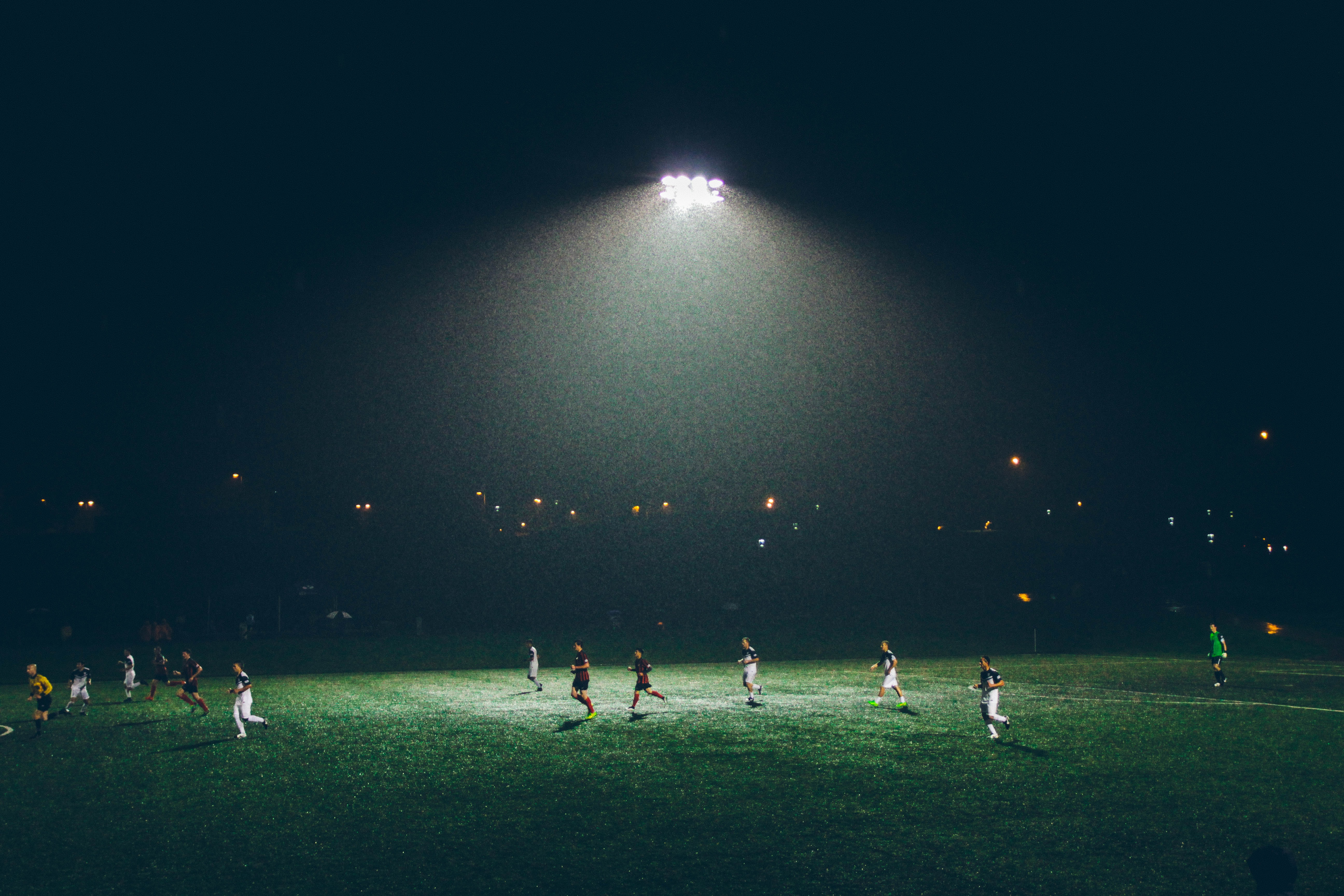 group of people playing soccer on soccer field