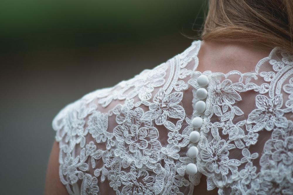 woman wearing white lace dress