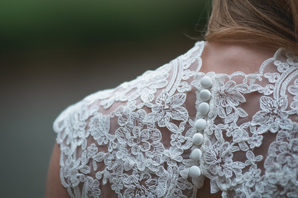 woman wearing white lace dress