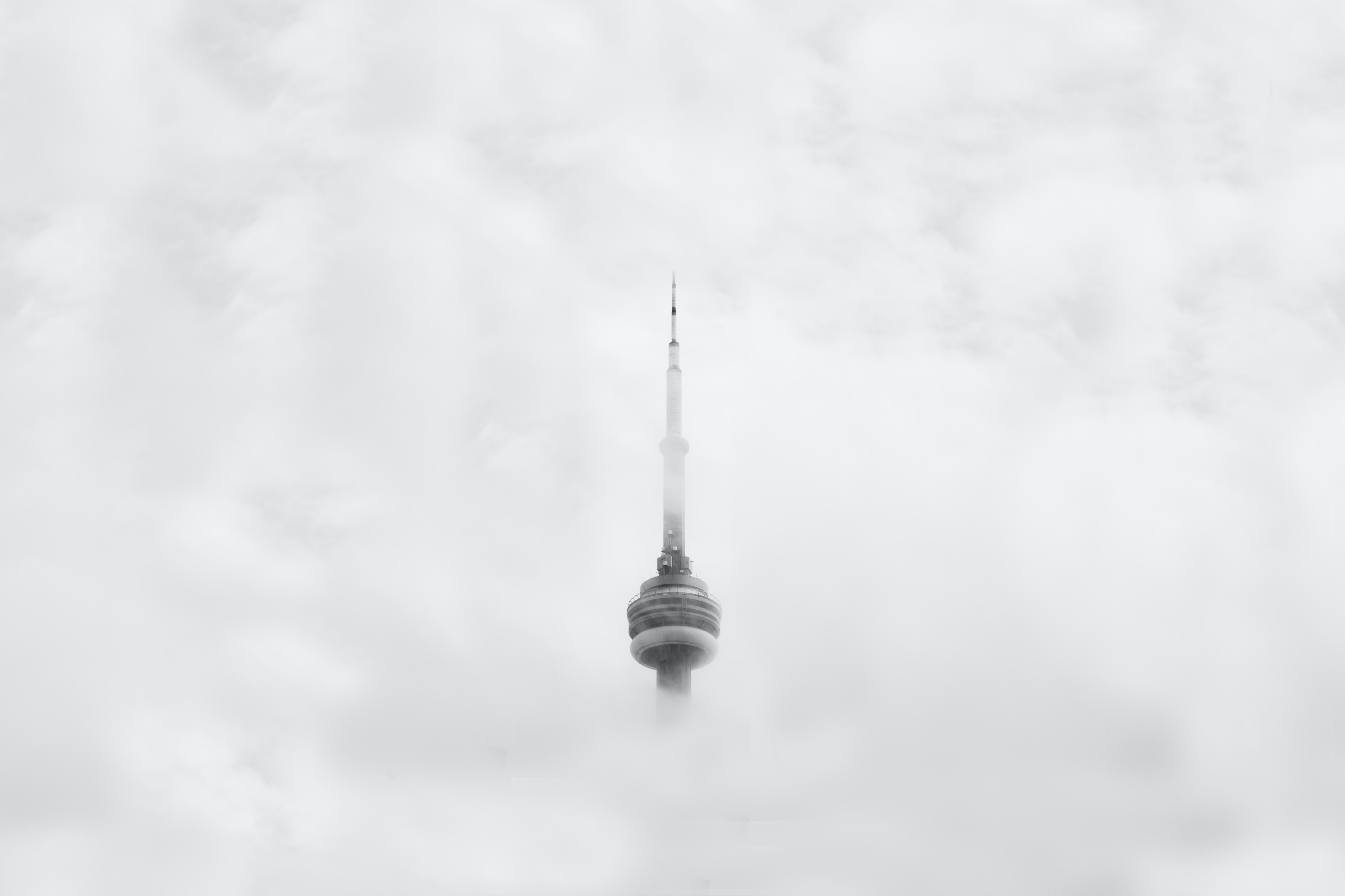 The CN Tower in Toronto shrouded in thick clouds