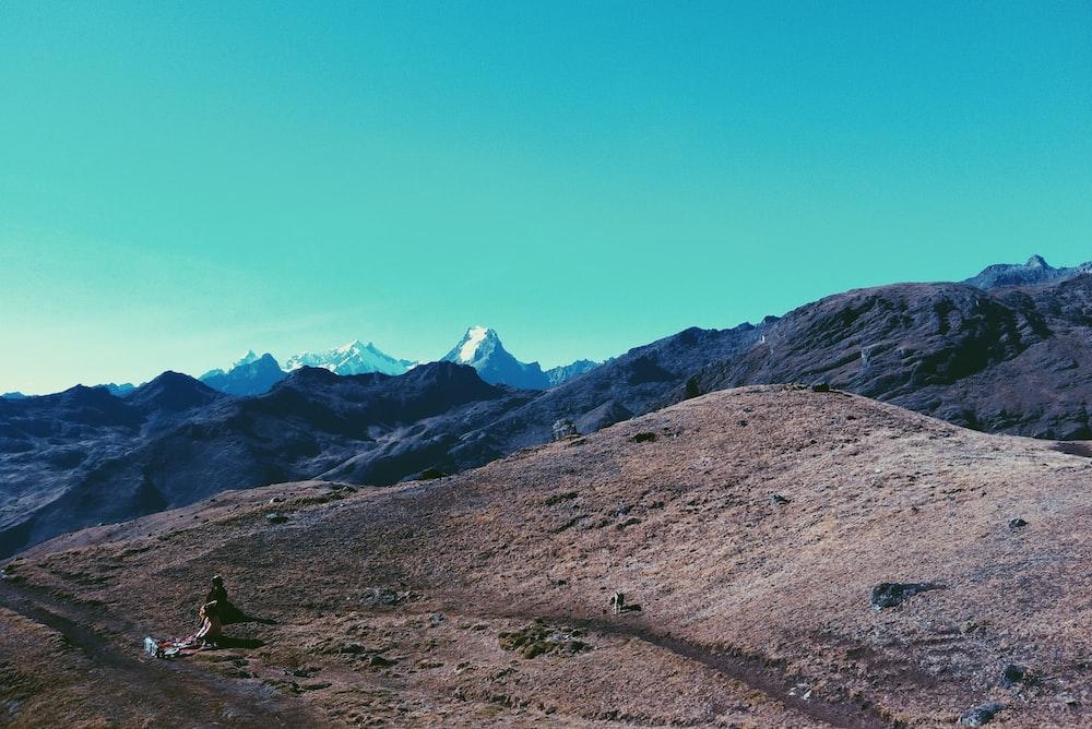 brown hills under clear blue sky